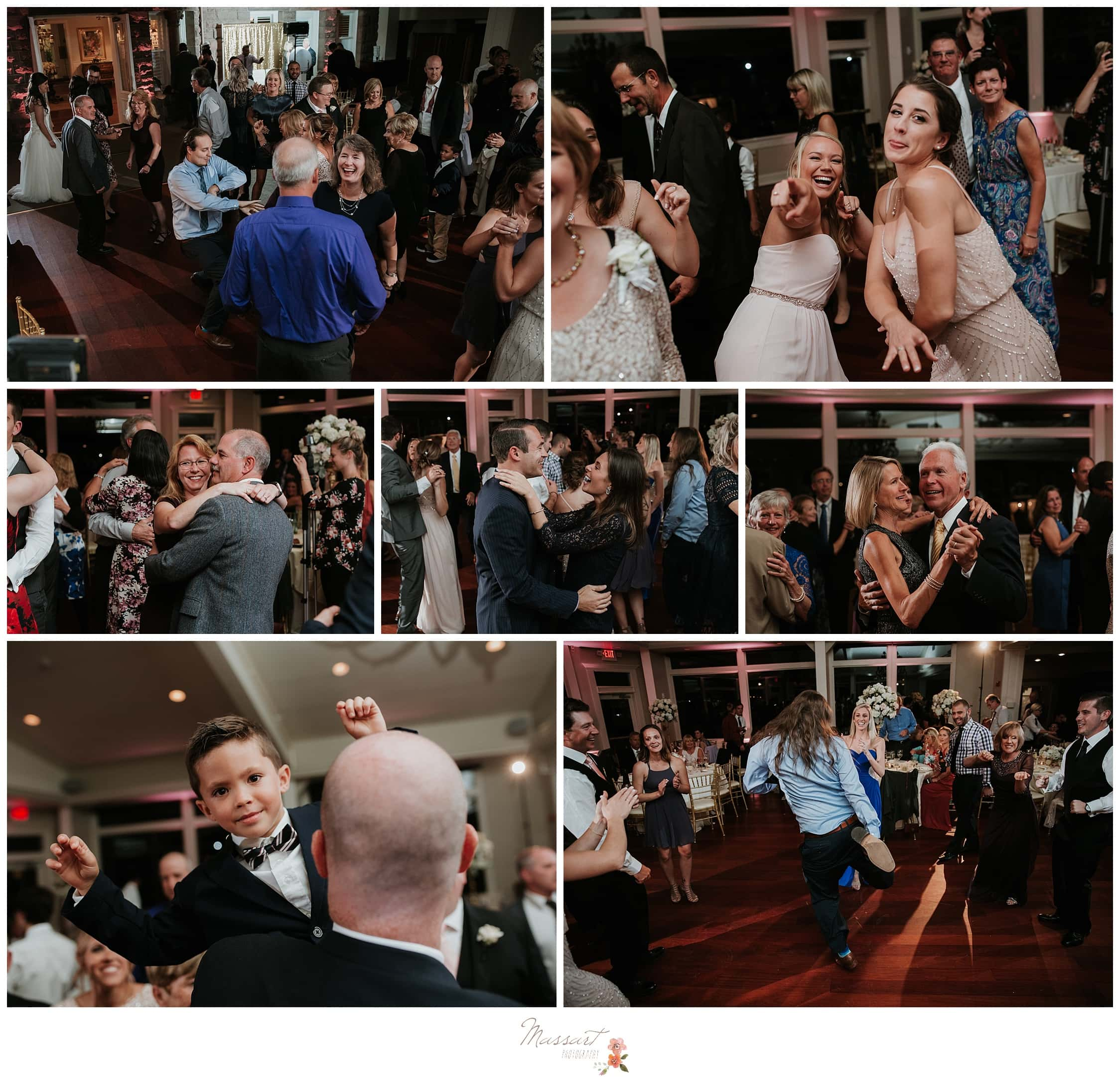 Wedding guests dance together at the reception photographed by Massart Photography RI