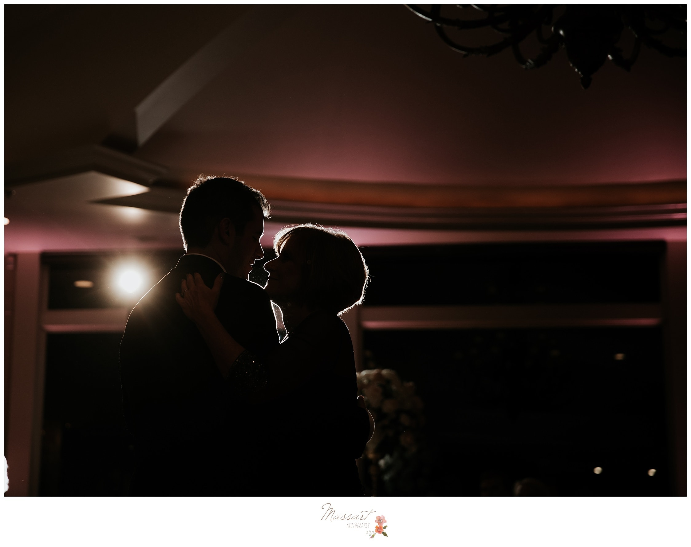 Mother and son dance during Ocean Cliff wedding reception photographed by Massart Photography Rhode Island