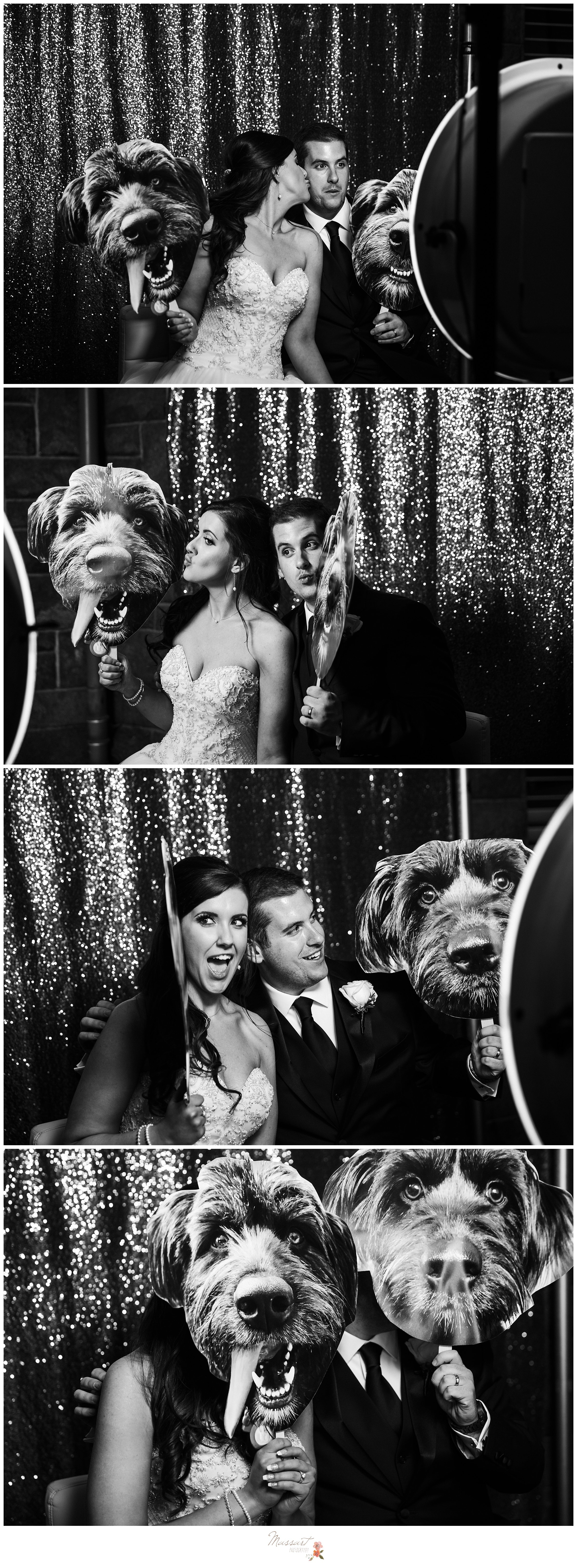 Bride and groom take portraits with the cardboard cutouts of their dog at the photo booth photographed by Massart Photography RI