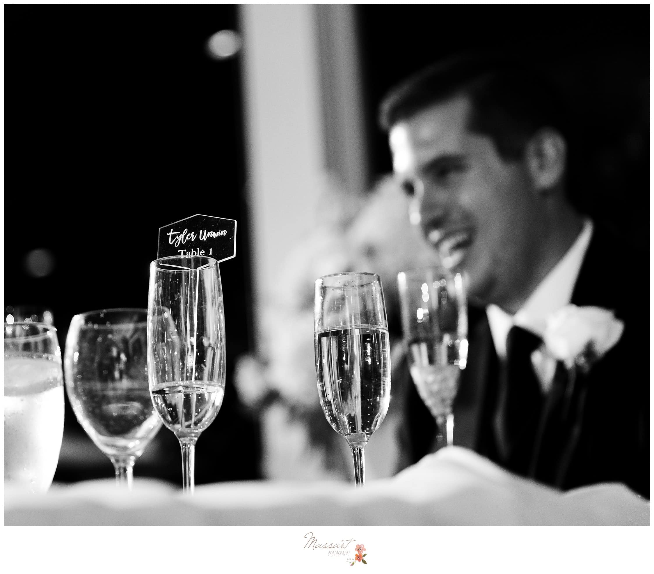 Black and white portrait of the groom at the wedding reception photographed by Massart Photography RI
