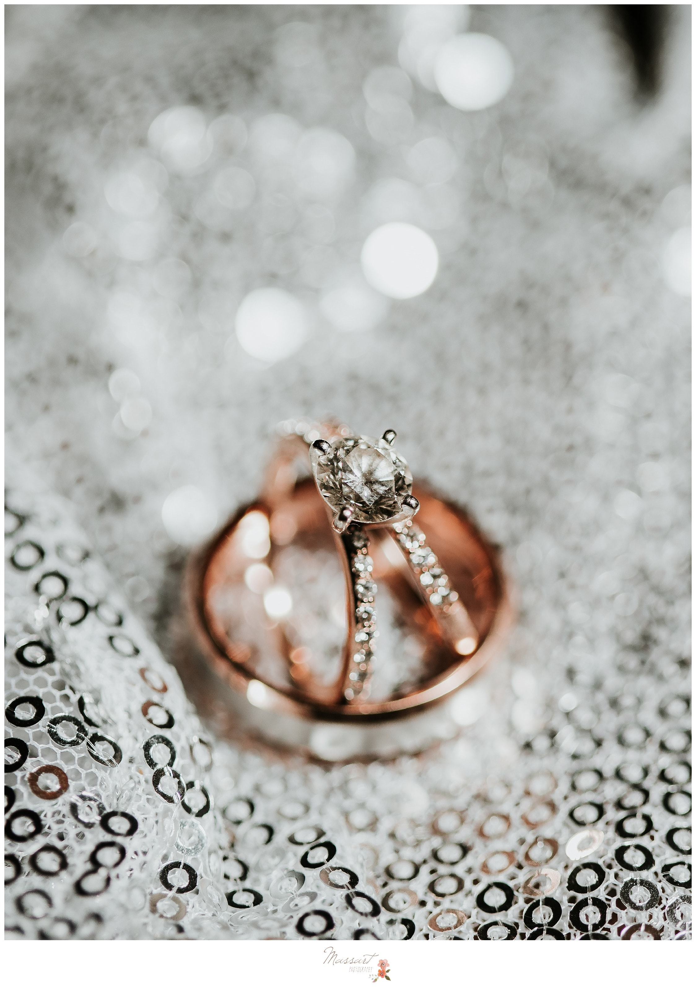 Portrait of the couple's rose gold wedding rings photographed by Massart Photography RI