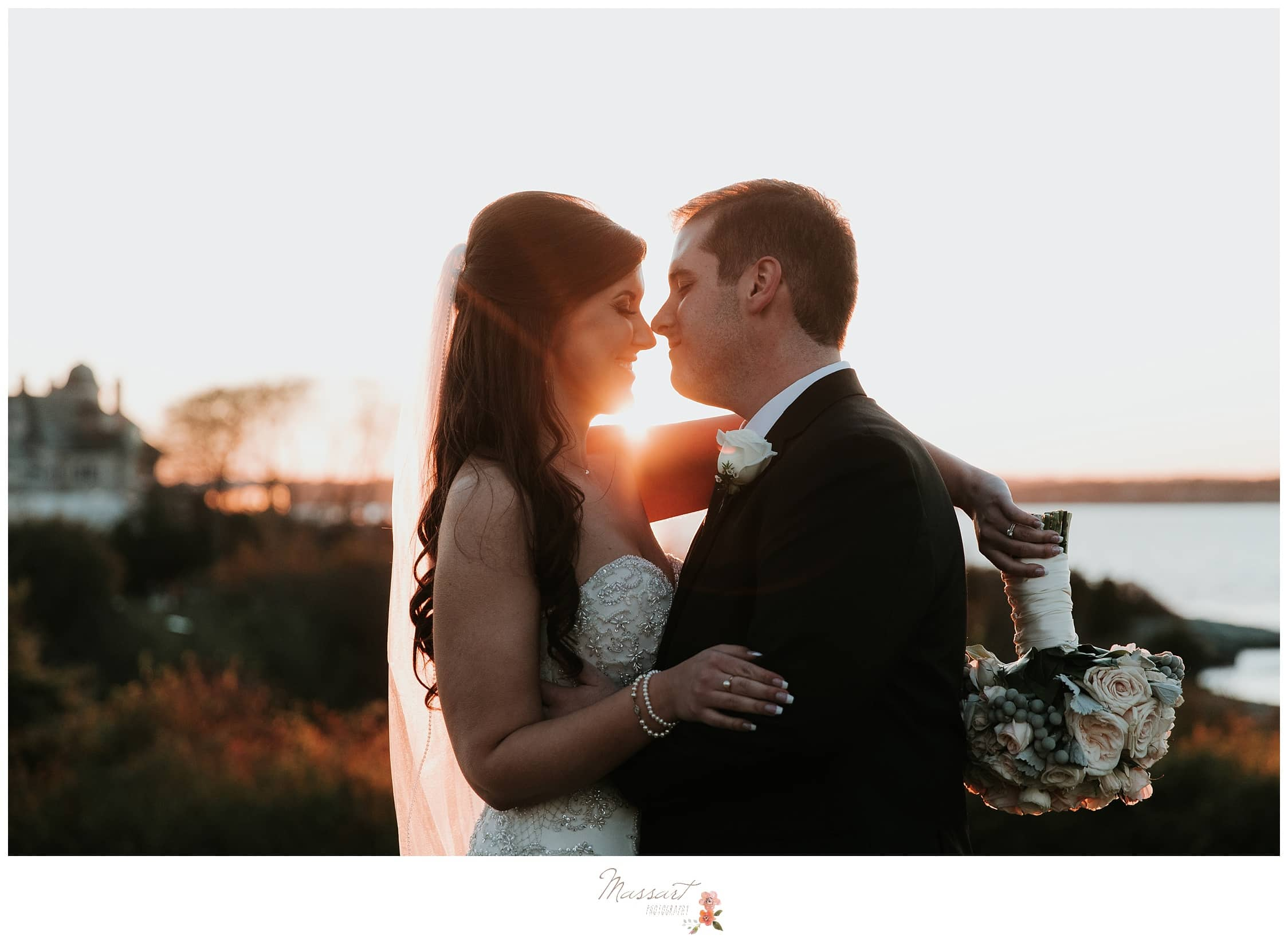 Bride and groom formal portraits with the sunset photographed by Massart Photography RI