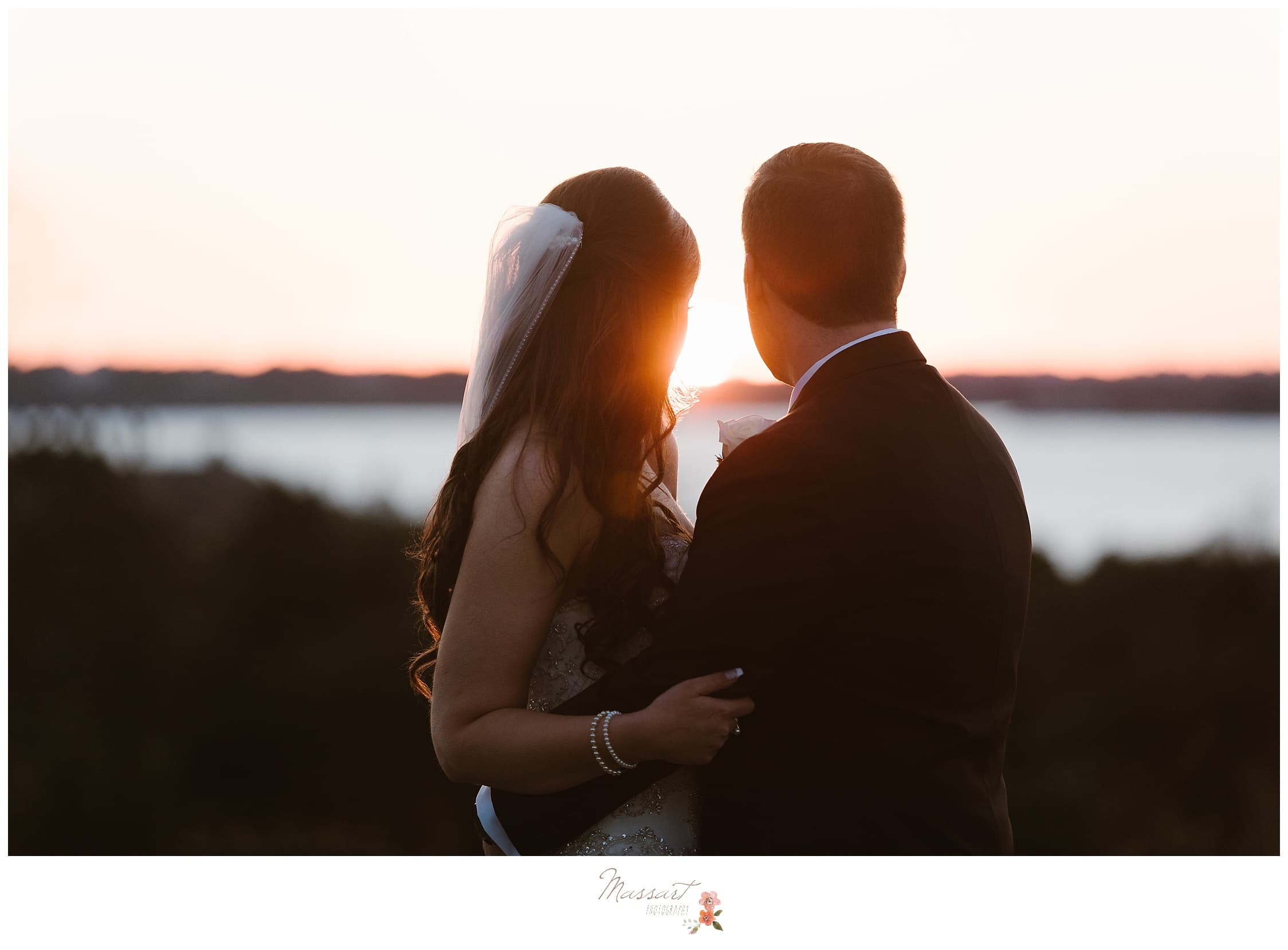 Newlyweds look out into the water on their wedding day photographed by Massart Photography RI