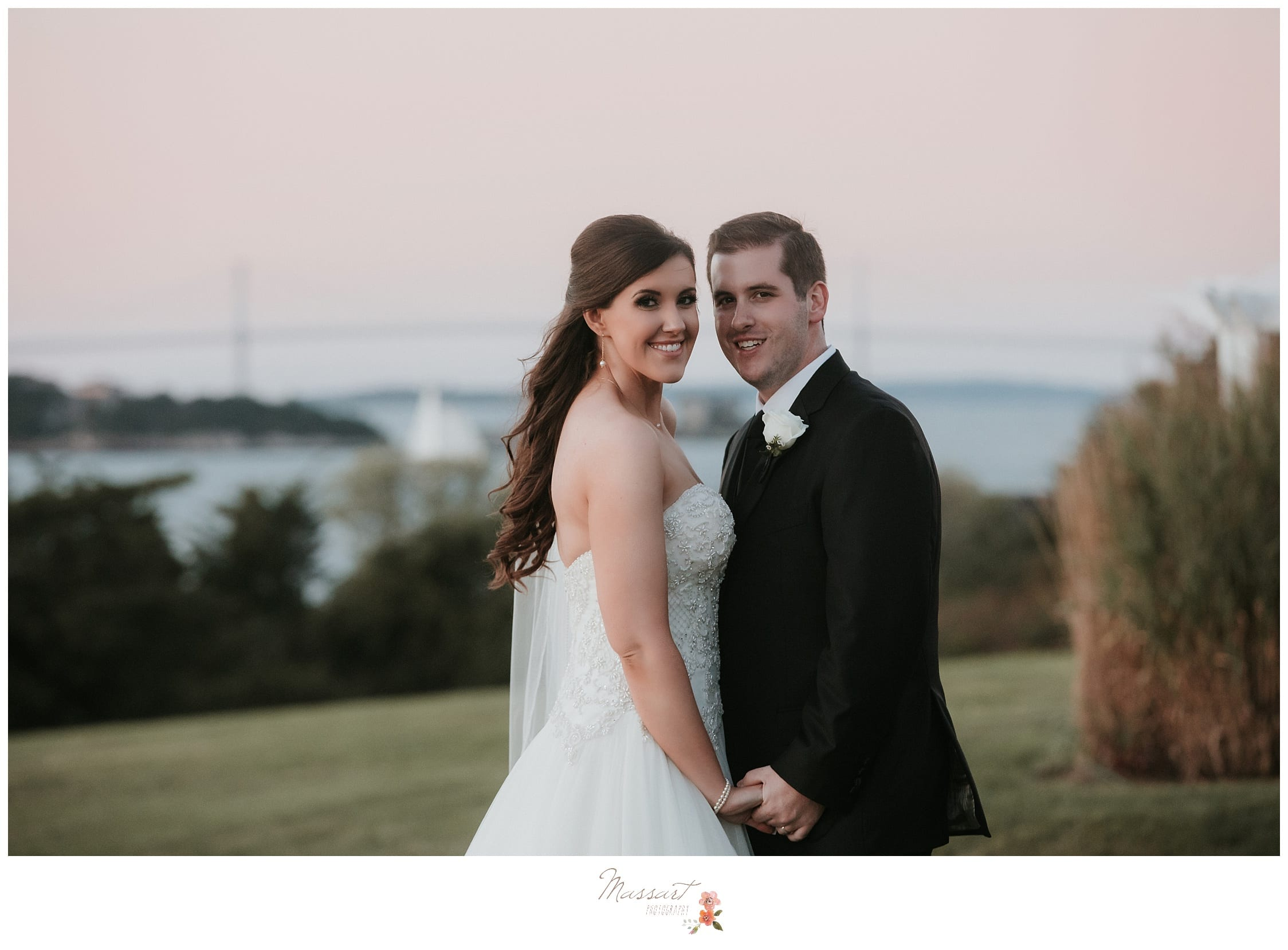Newlyweds take their formal portraits at the Ocean Cliff wedding photographed by Massart Photography RI