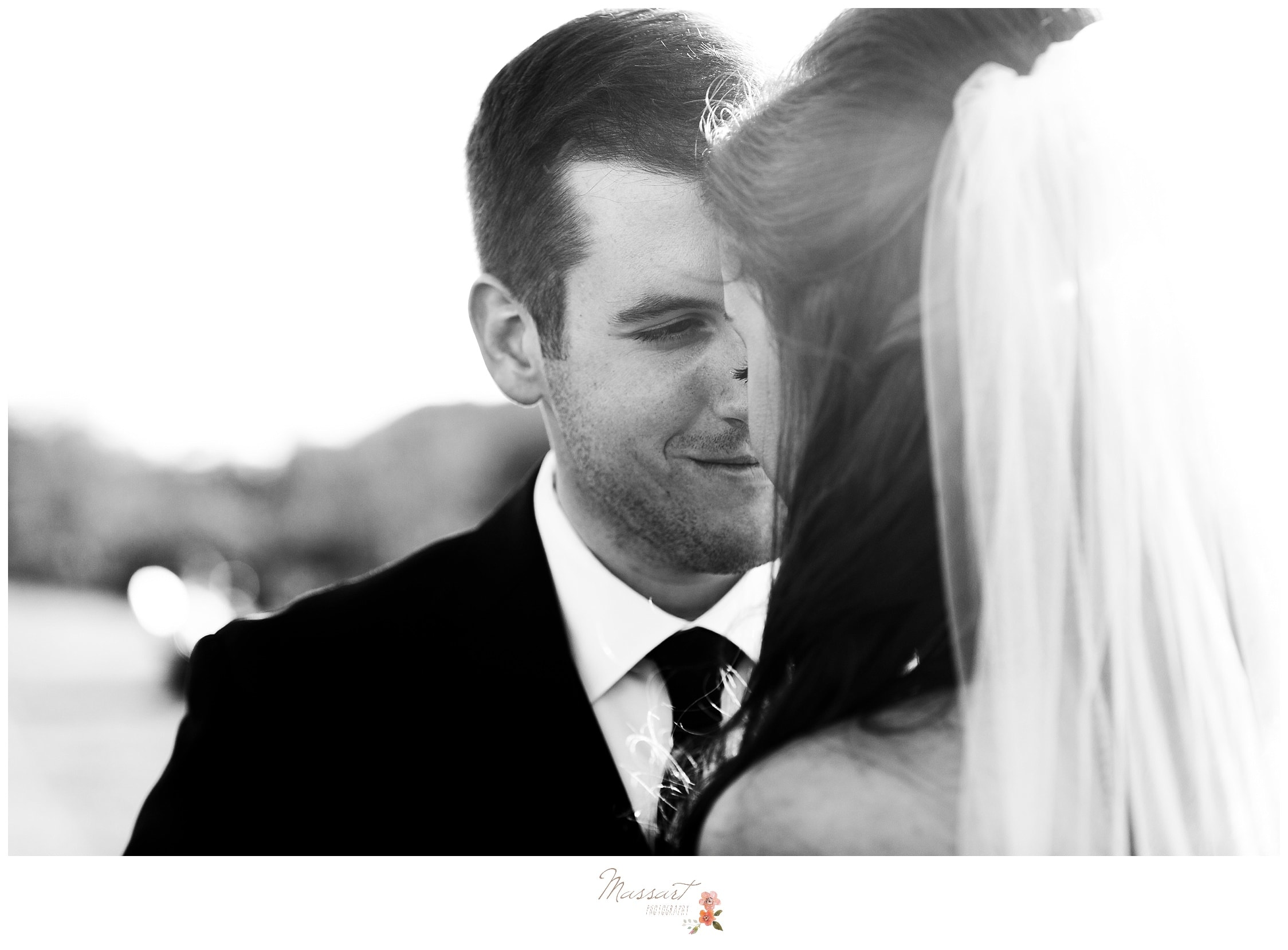 Black and white portrait of the groom looking at his beautiful bride photographed by Massart Photography Rhode Island
