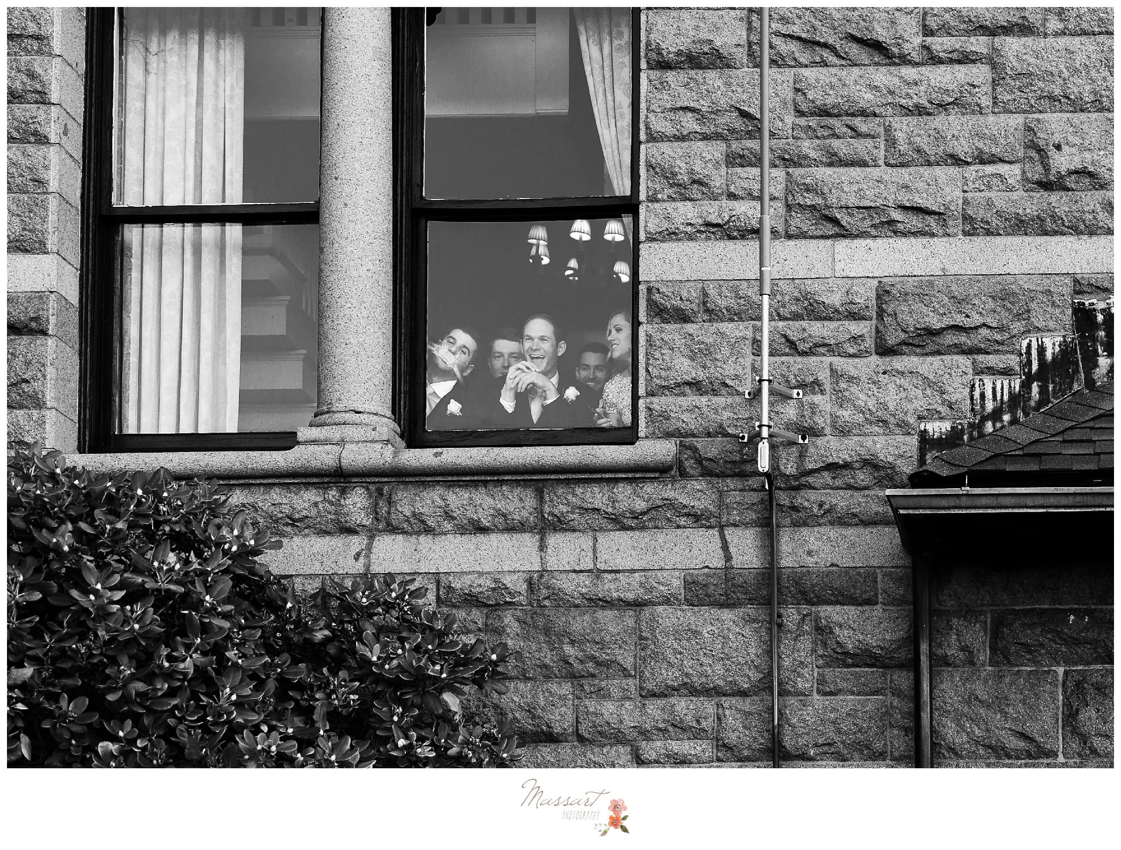 Wedding party sneaks a look at the bride and groom private first look moment photographed by Massart Photography RI