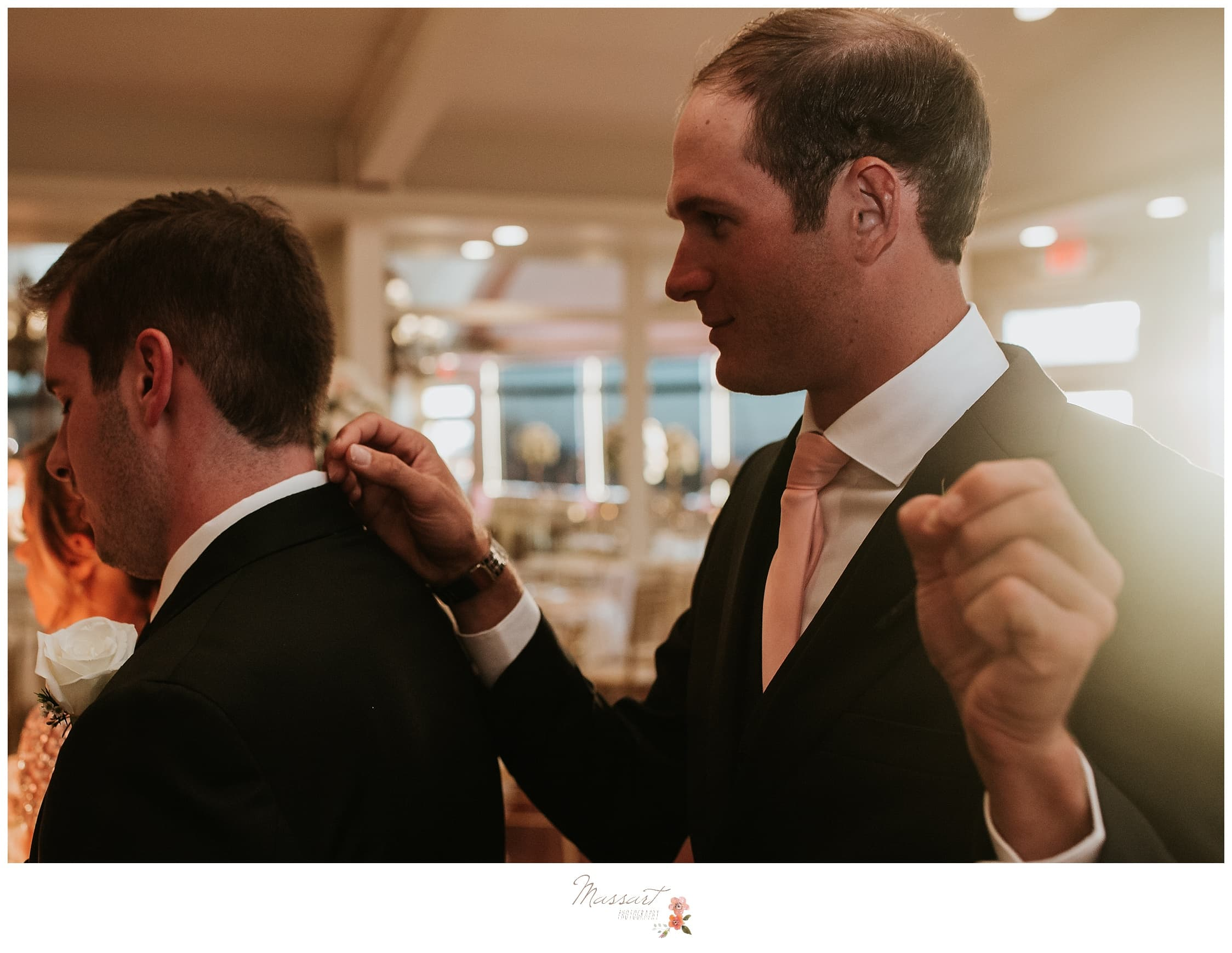 Groomsmen plays prank on the groom before the wedding ceremony photographed by Massart Photography Rhode Island