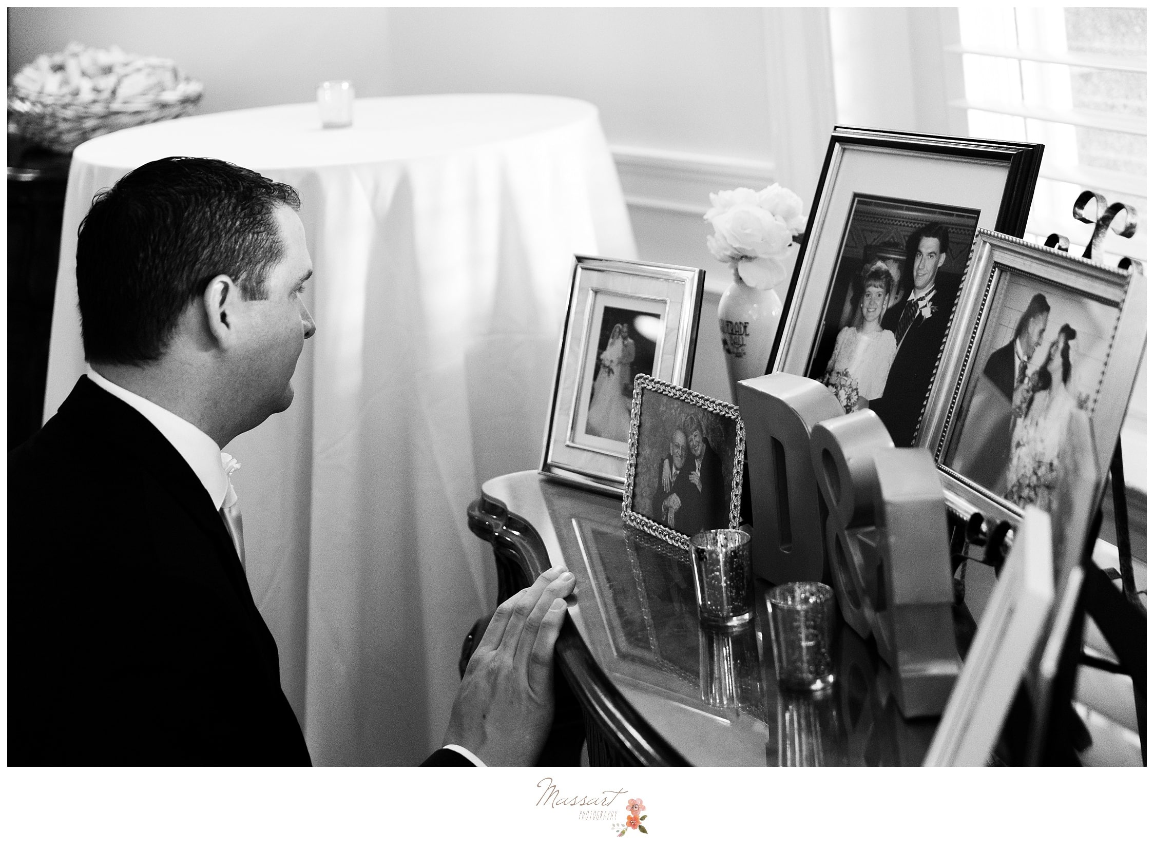 Guests admire the memory table of the loved ones who passed away photographed by Massart Photography RI