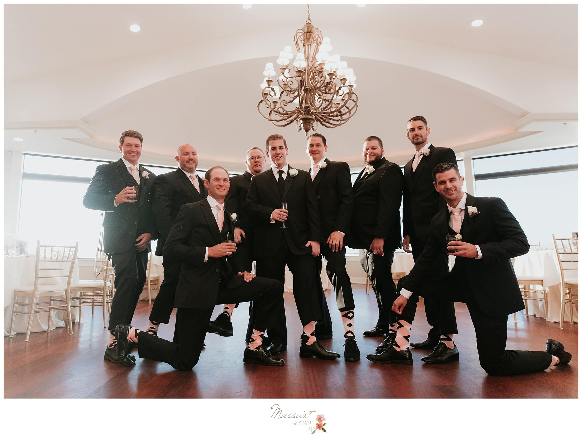 Groom and groomsmen show off their socks before wedding ceremony photographed by Massart Photography Rhode Island