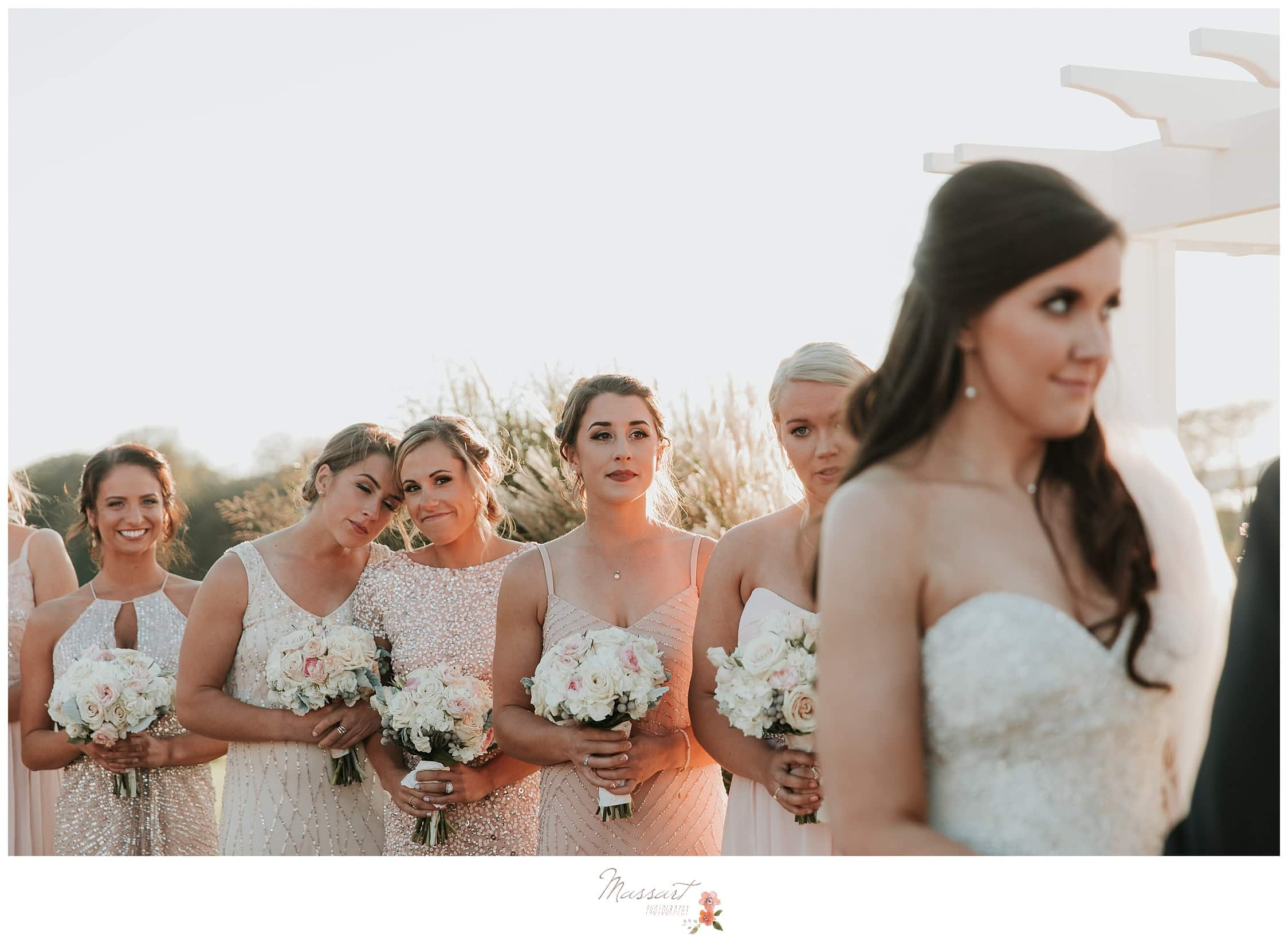Bridesmaids get emotional watching their bride get married photographed by Massart Photography Rhode Island