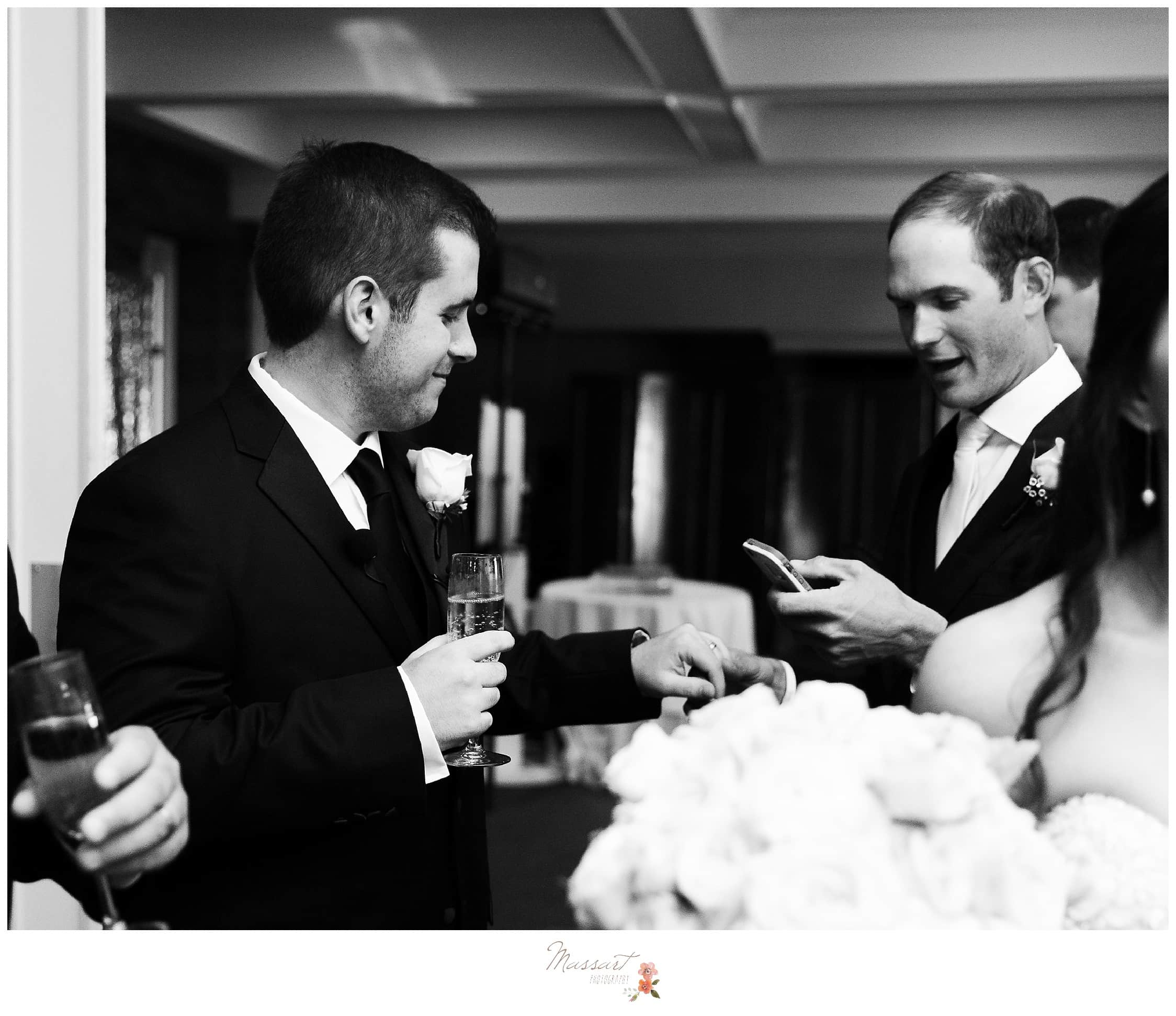Groom and groomsmen share a sweet moment after the wedding ceremony photographed by Massart Photography RI