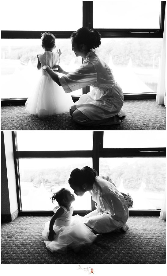 Black and white portraits of the bride helping her flower girl get ready before the wedding ceremony photographed by Massart Photography Rhode Island