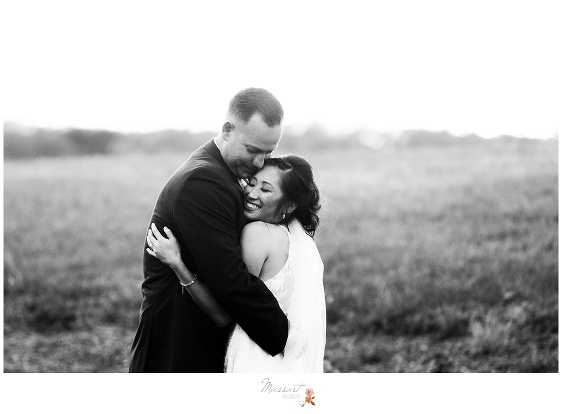 The happy couple is all smiles after the Crowne Plaza wedding ceremony captured by Massart Photography Rhode Island