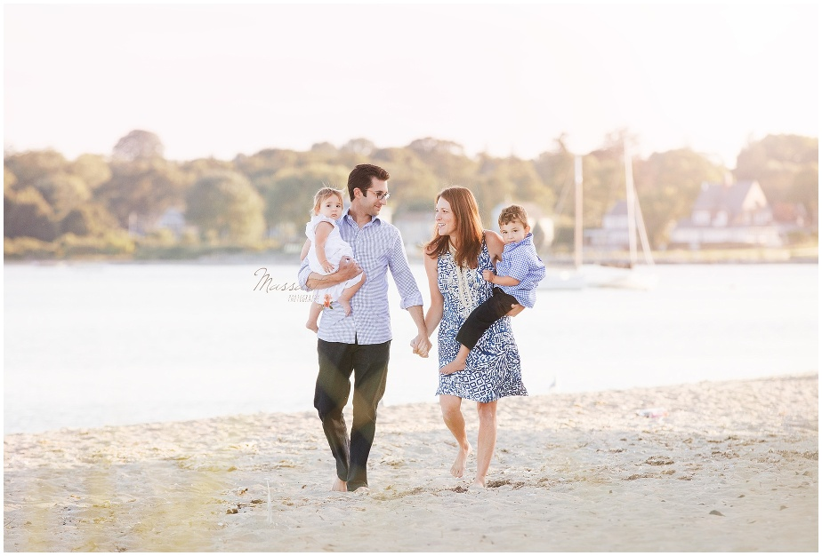 Family walks on the beach during their summer family portrait session photographed by Massart Photography Rhode Island