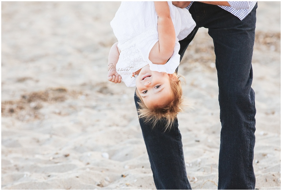 Dad plays with his daughter on the beach during the summer family portrait captured by Massart Photography RI