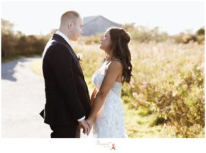 Bride and groom outside before their wedding ceremony photographed by Massart Photography Rhode Island