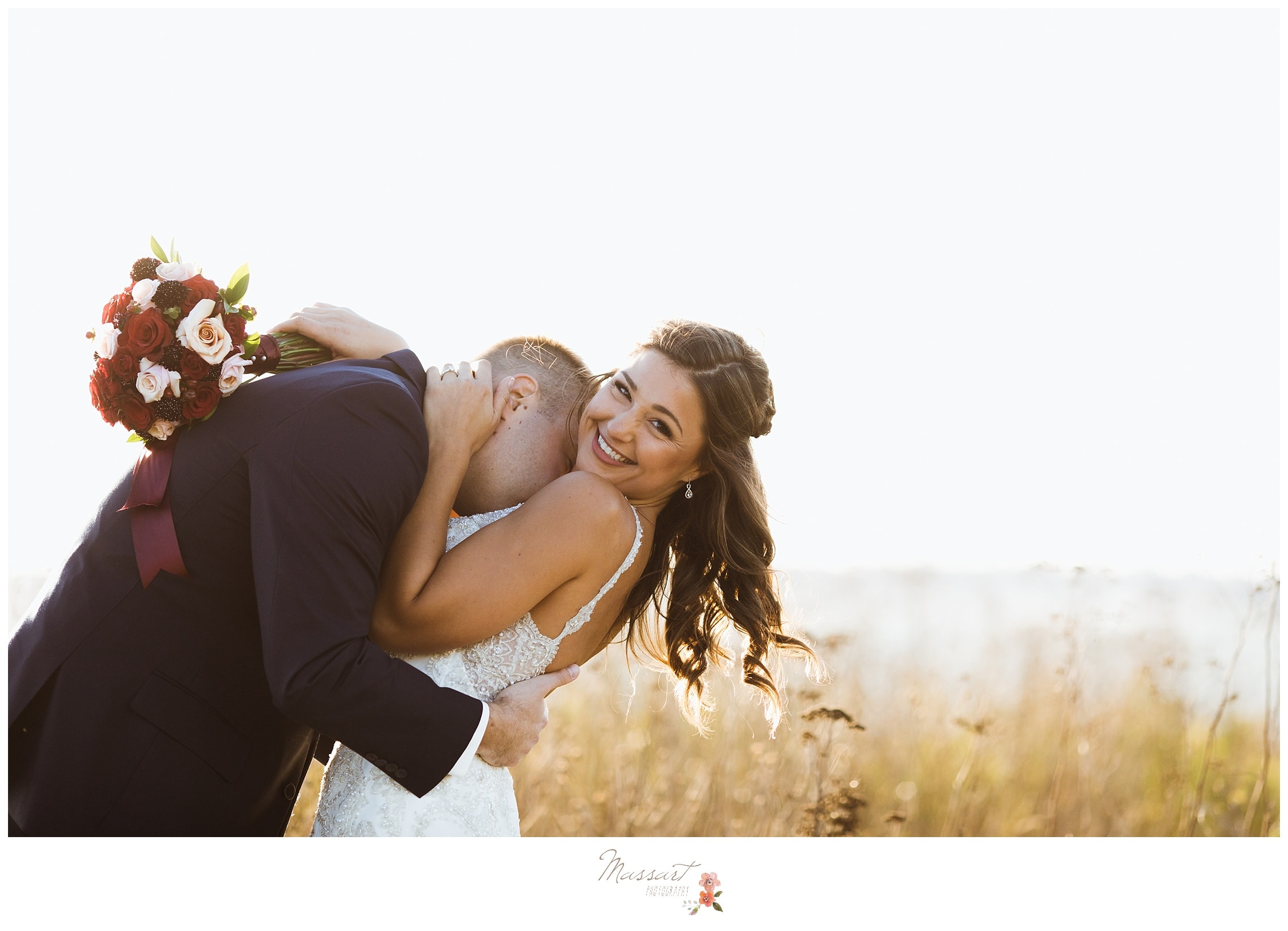 Groom kisses his bride before the Newport, RI wedding captured by Massart Photography RI
