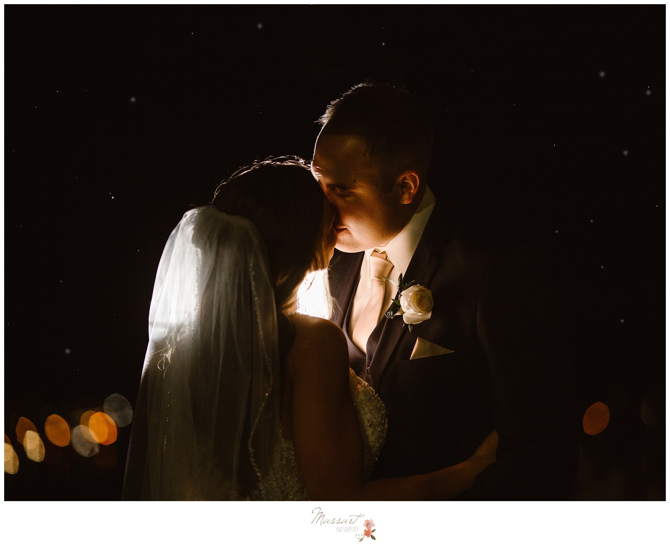 Romantic portrait of the bride and groom sharing a special moment during their first dance photographed by Massart Photography Rhode Island