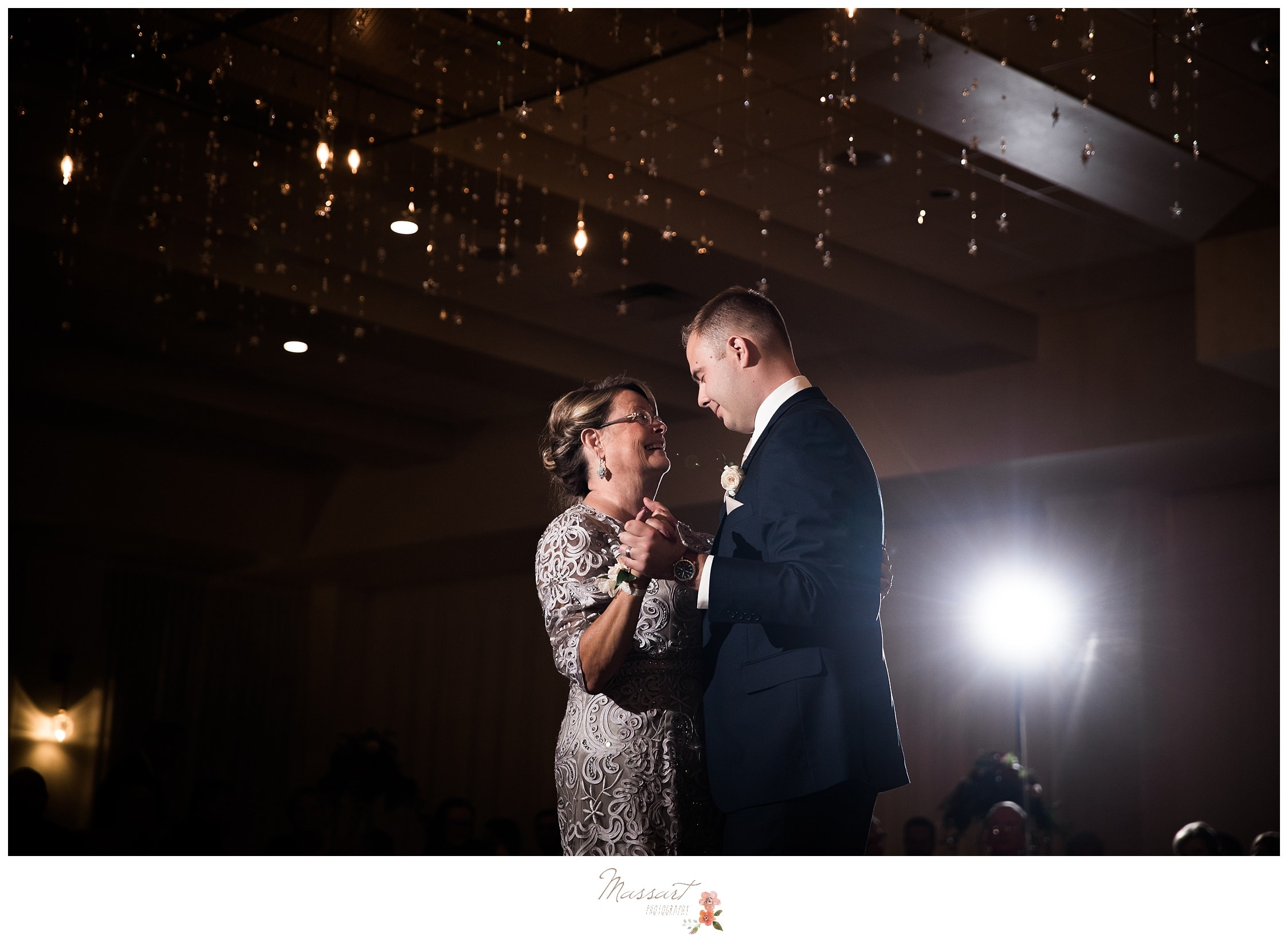 The groom and his mother share a dance together at the wedding reception photographed by Massart Photography RI