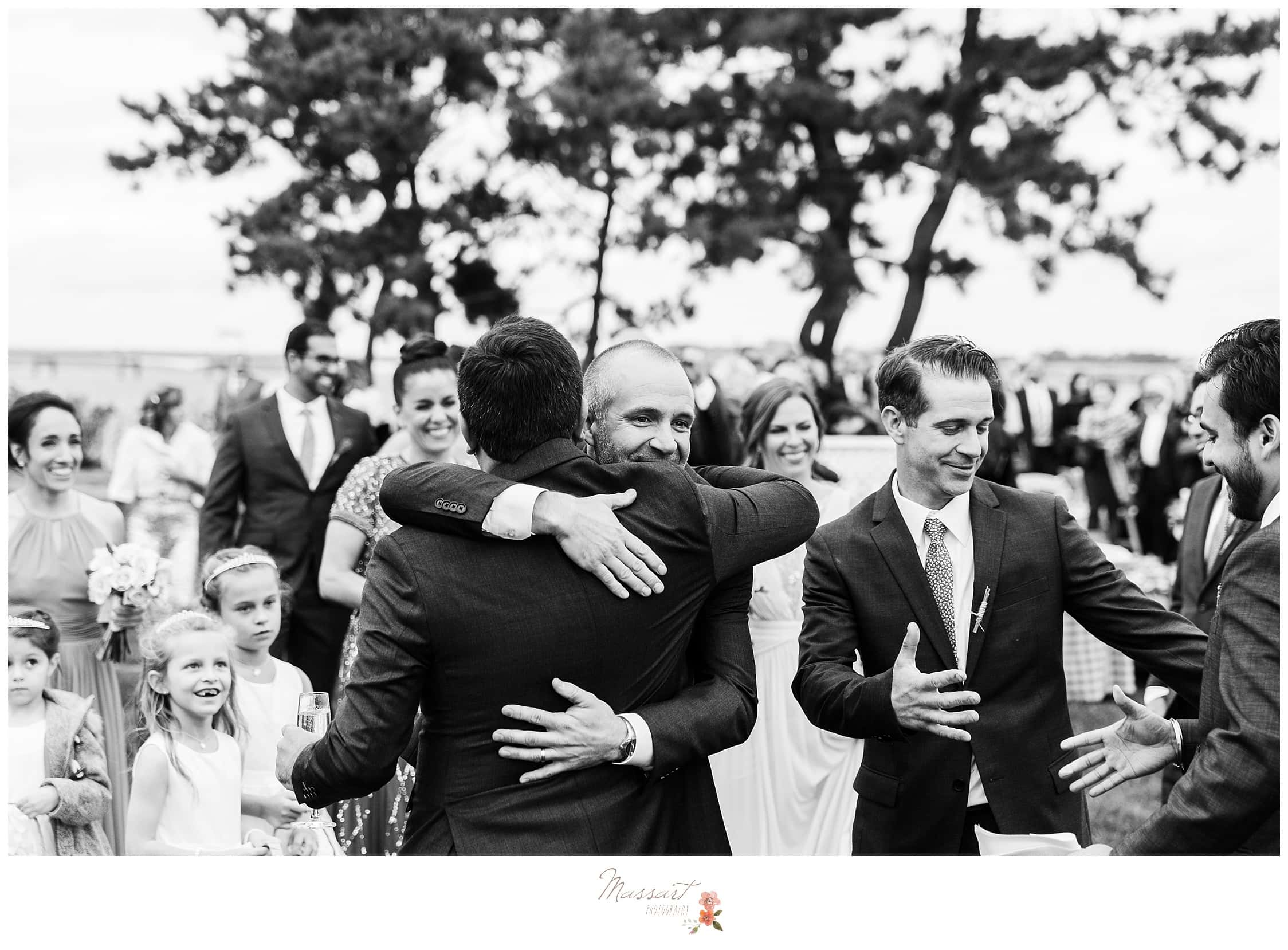Groom hugging his father after the wedding ceremony photographed by Massart Photography RI