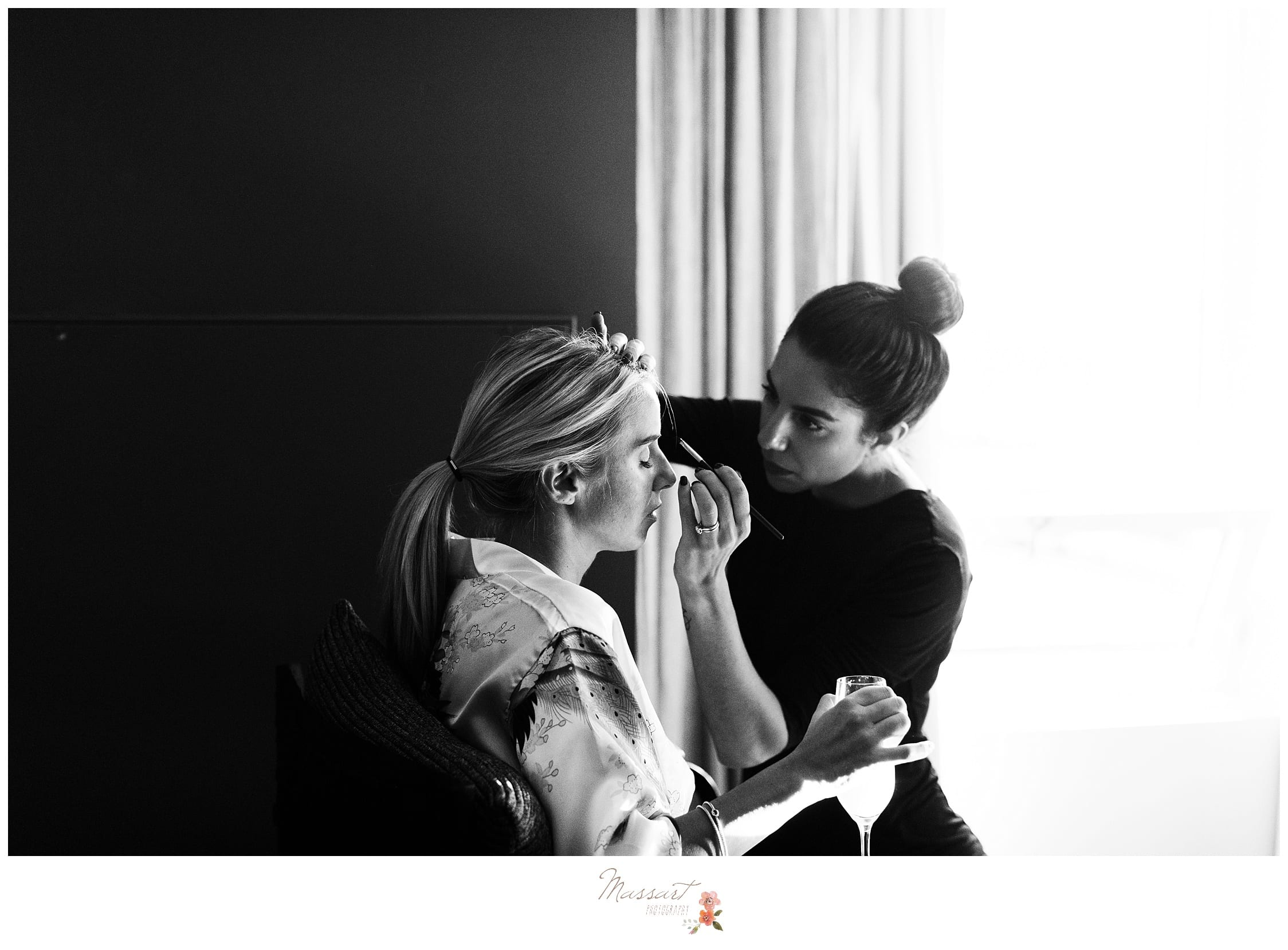 Black and white portrait of the bride getting her makeup done photographed by Massart Photography Rhode Island