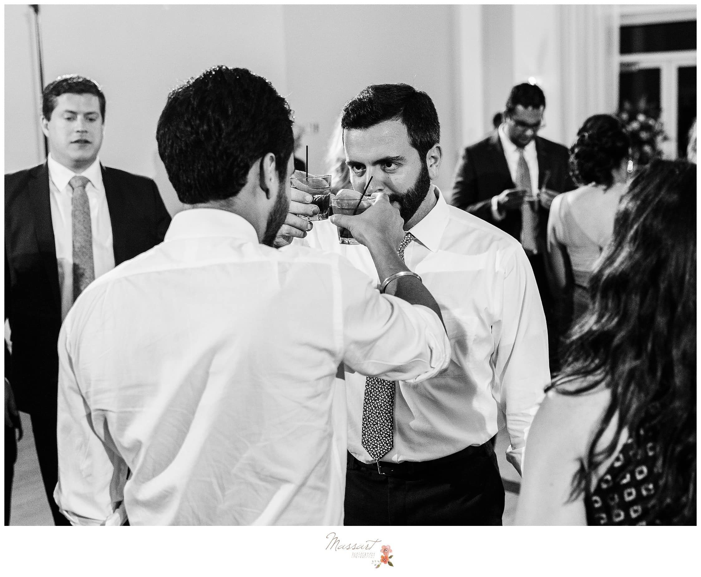 Groom and his friends sharing a toast at the wedding reception photographed by Massart Photography Rhode Island