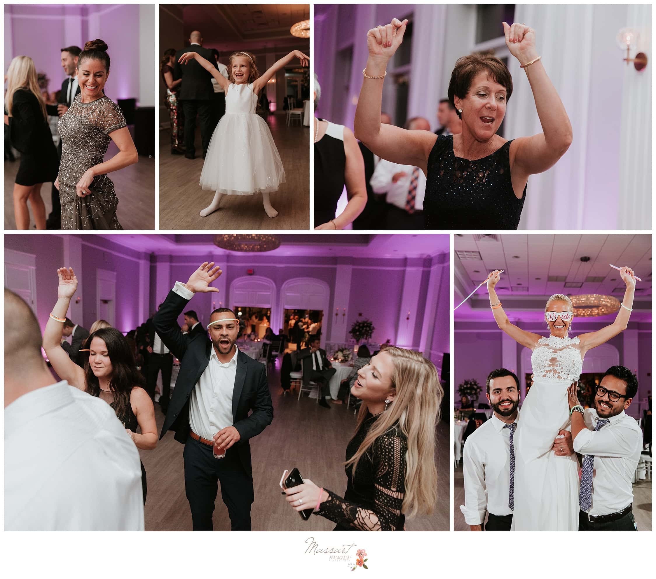 Wedding guests dance and have a fun time with the bride and groom photographed by Massart Photography Rhode Island