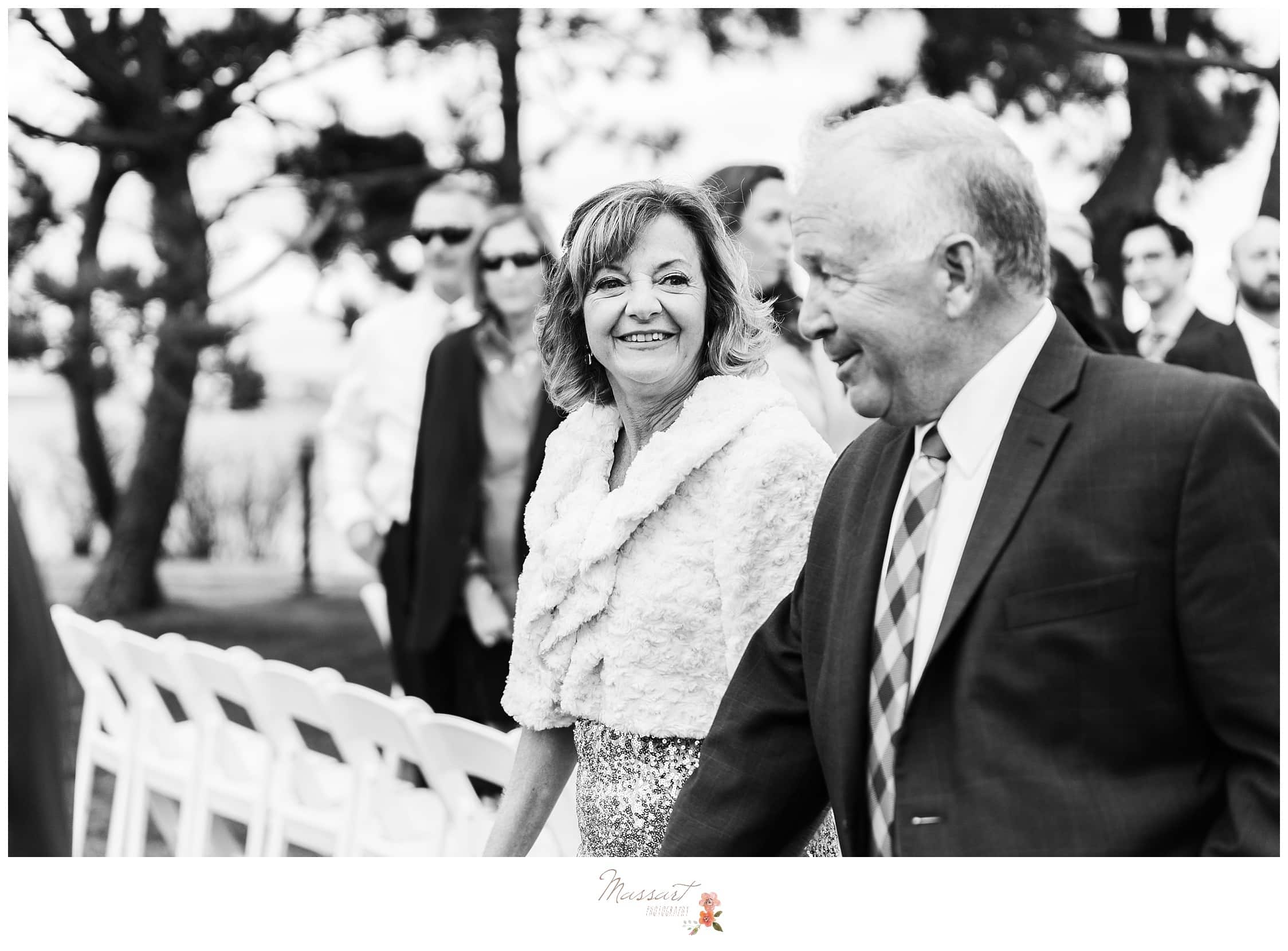 The bride's mother and father during the wedding ceremony photographed by Massart Photography Rhode Island