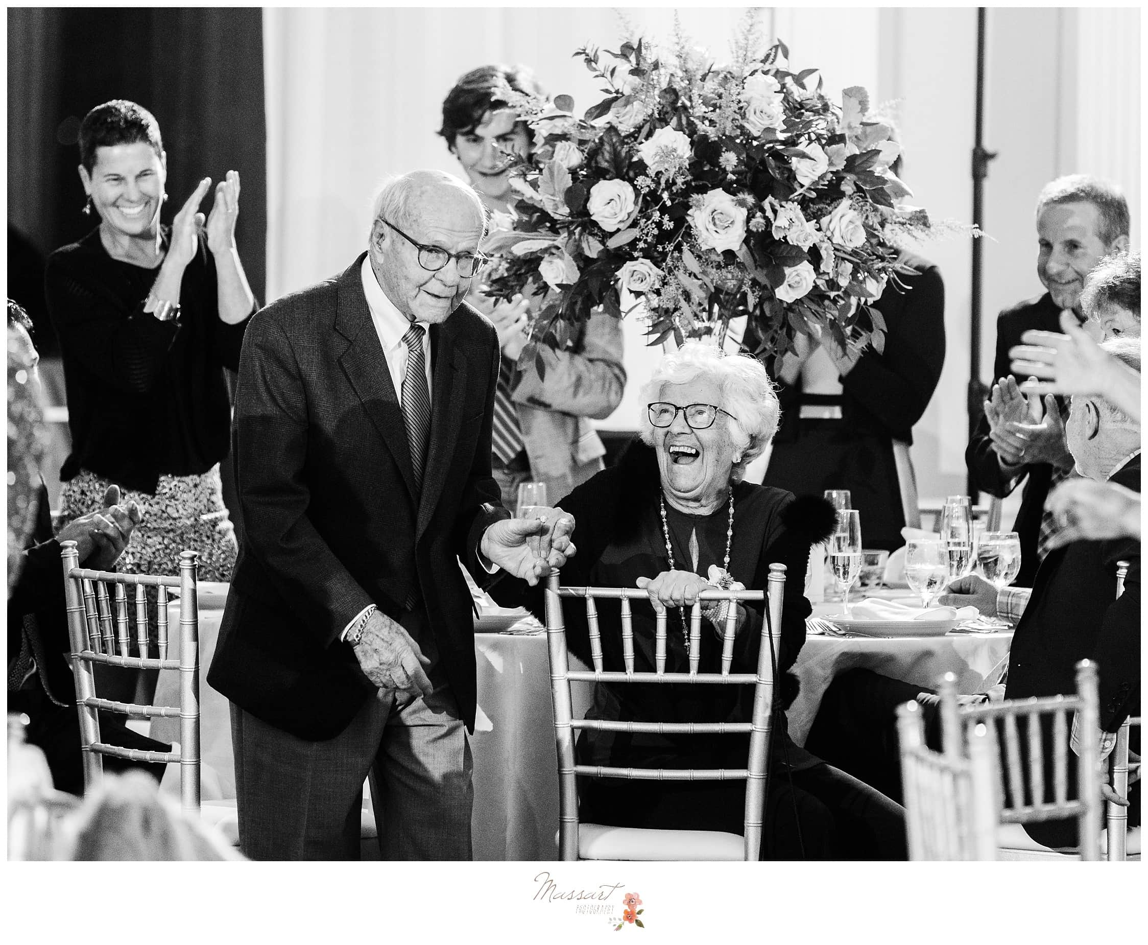 The bride's grandparents having fun at the wedding reception photographed by Massart Photography Rhode Island