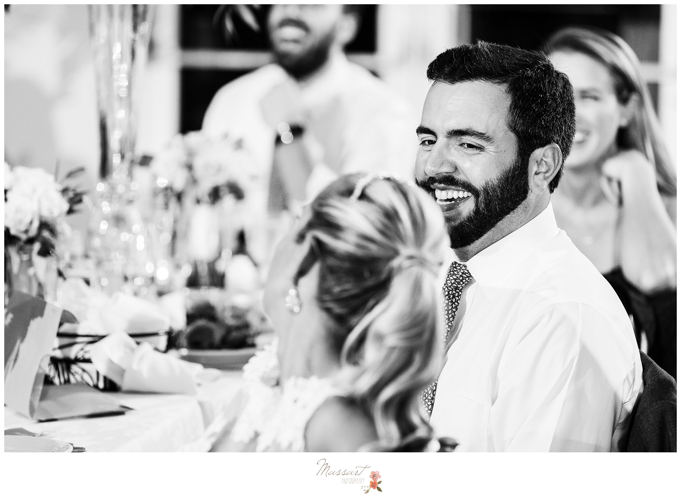 Black and white portrait of the bride and groom having a good time at their wedding ceremony photographed by Massart Photography RI