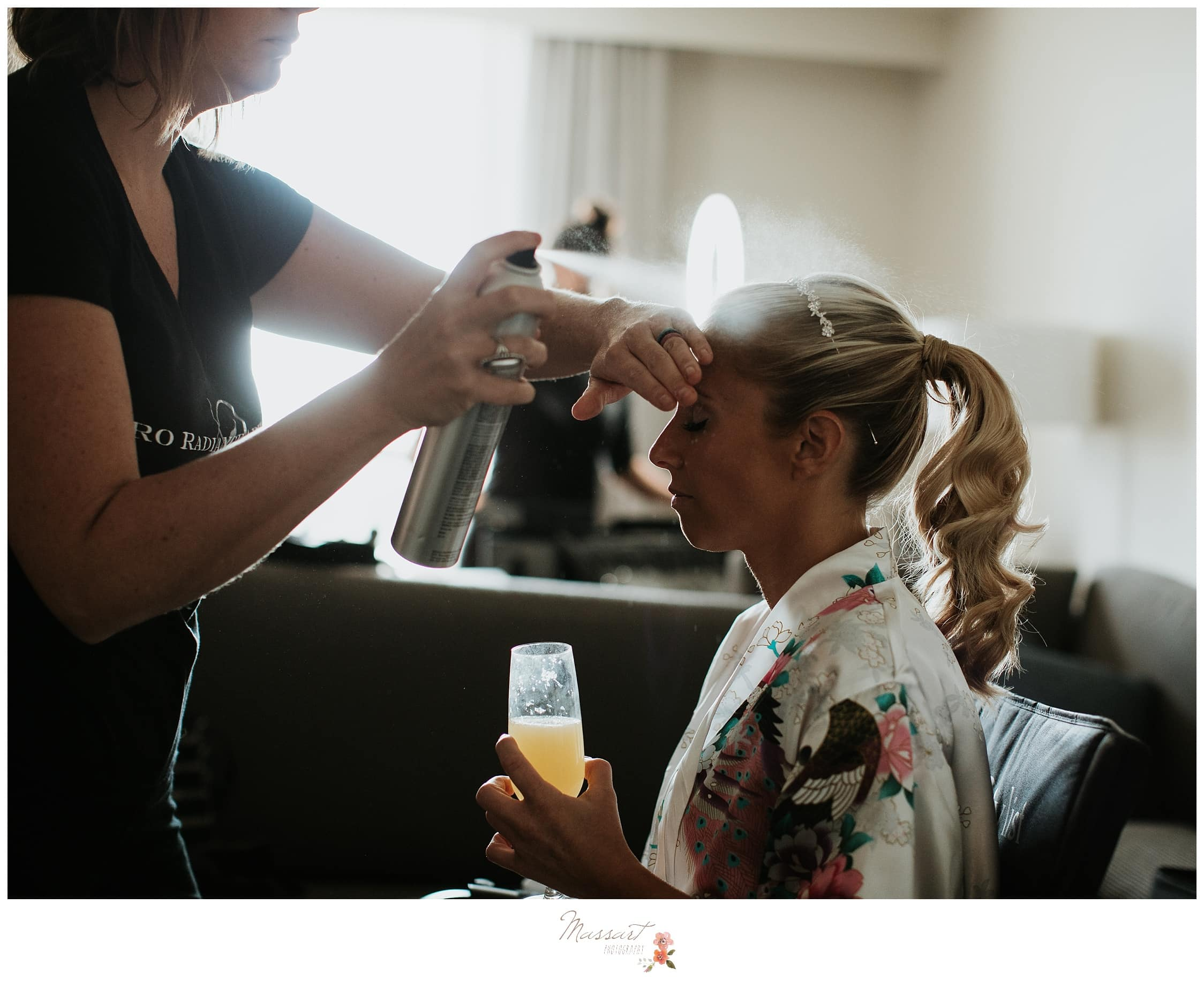 Finishing touches of the bride's hair before the wedding ceremony photographed by Massart Photography Rhode Island