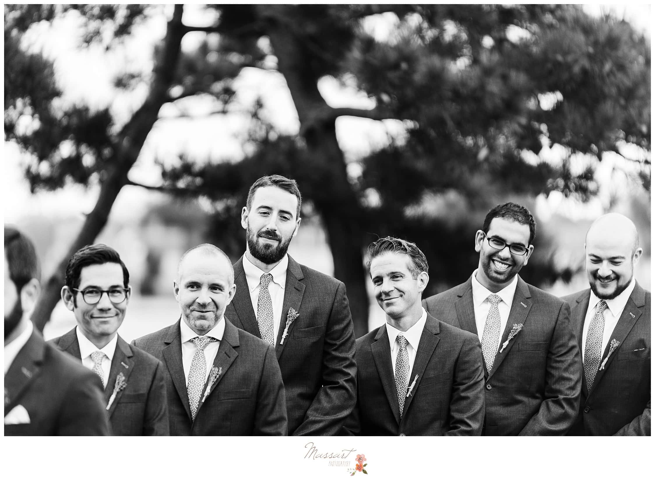 Groomsmen watch the bride and groom getting married photographed by Massart Photography RI