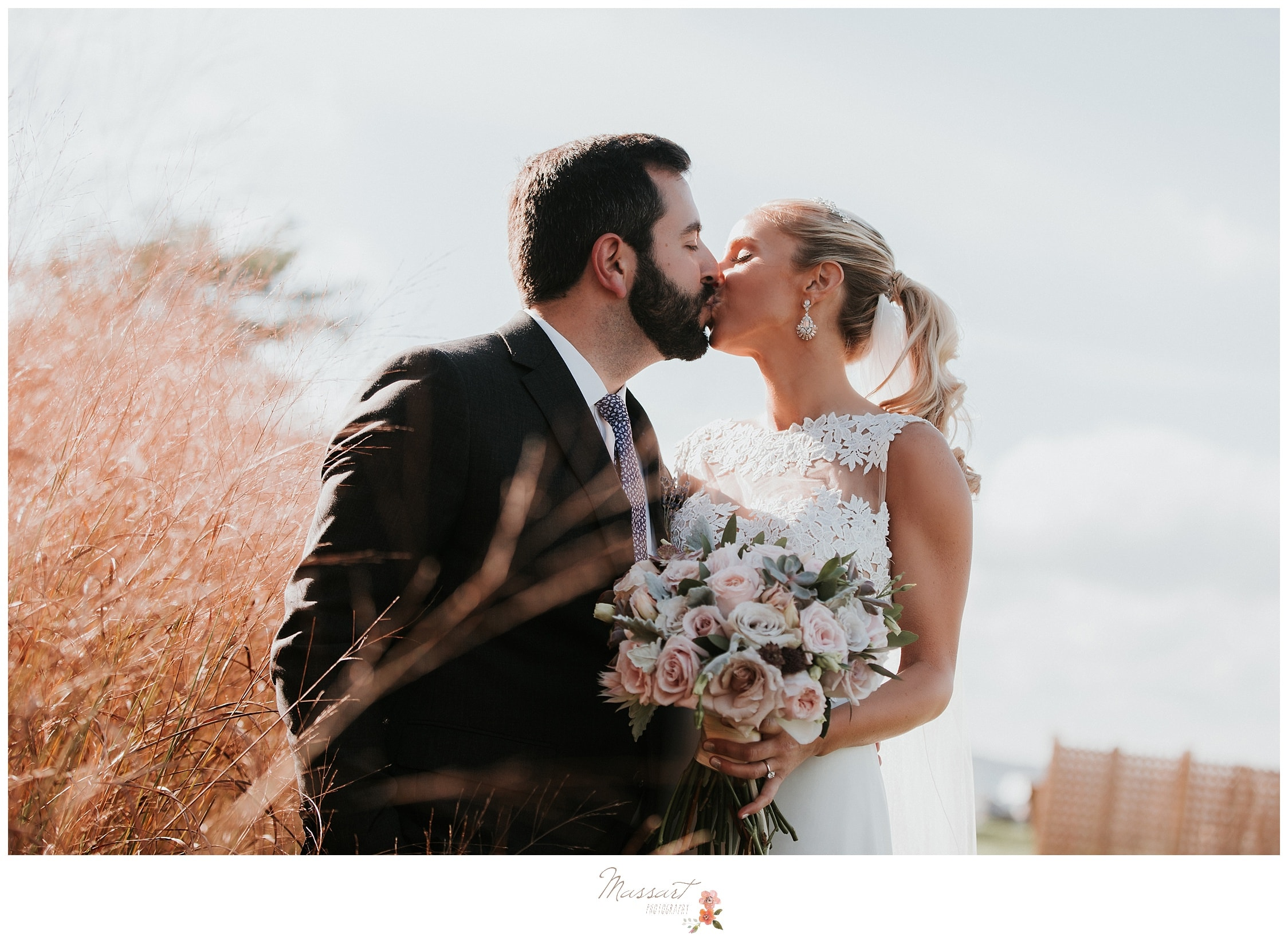 Bride and groom kissing during formal portraits photographed by Massart Photography RI