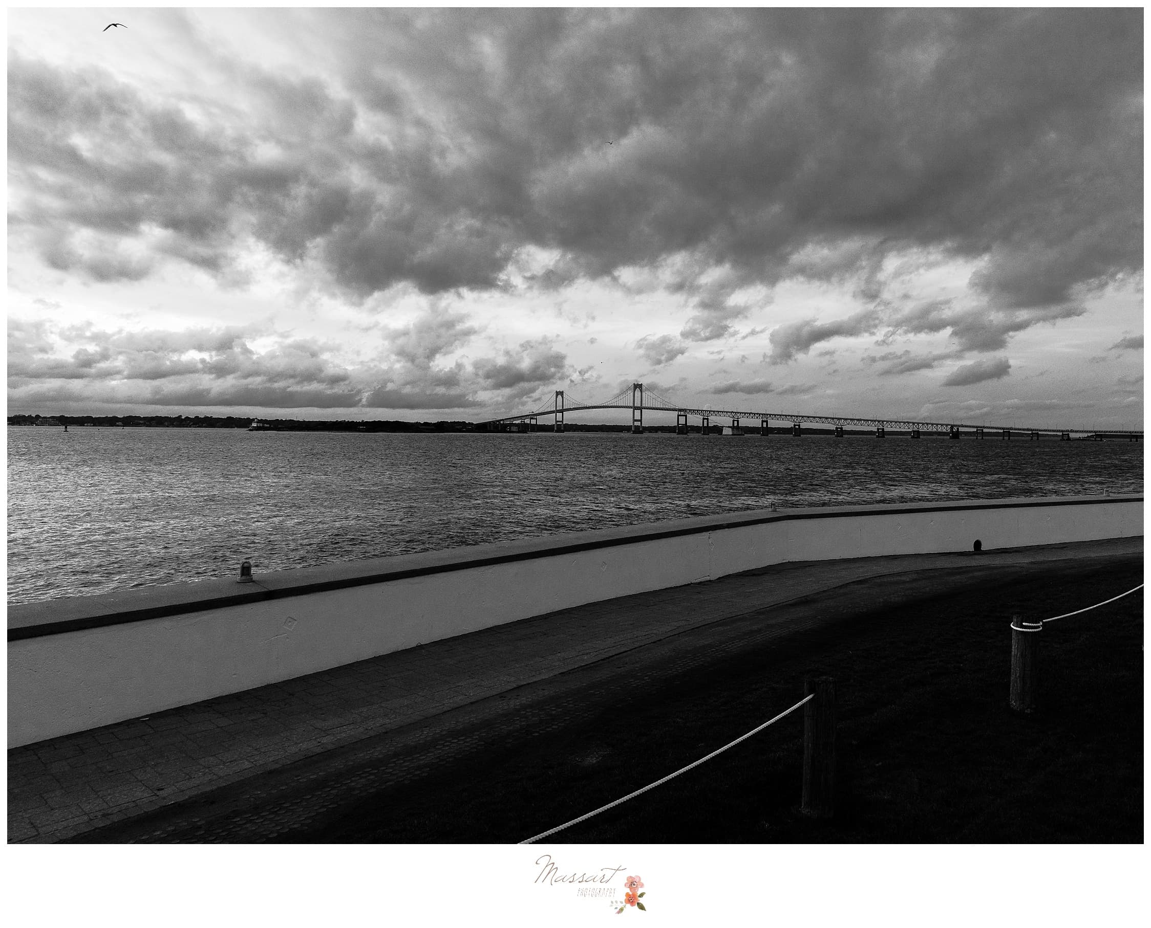 Black and white portrait of the water with the Newport Bridge in the background photographed by Massart Photography Rhode Island
