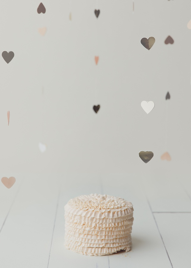 RI CT MA cake smash photographer Massart photography peach cake silver heart set up