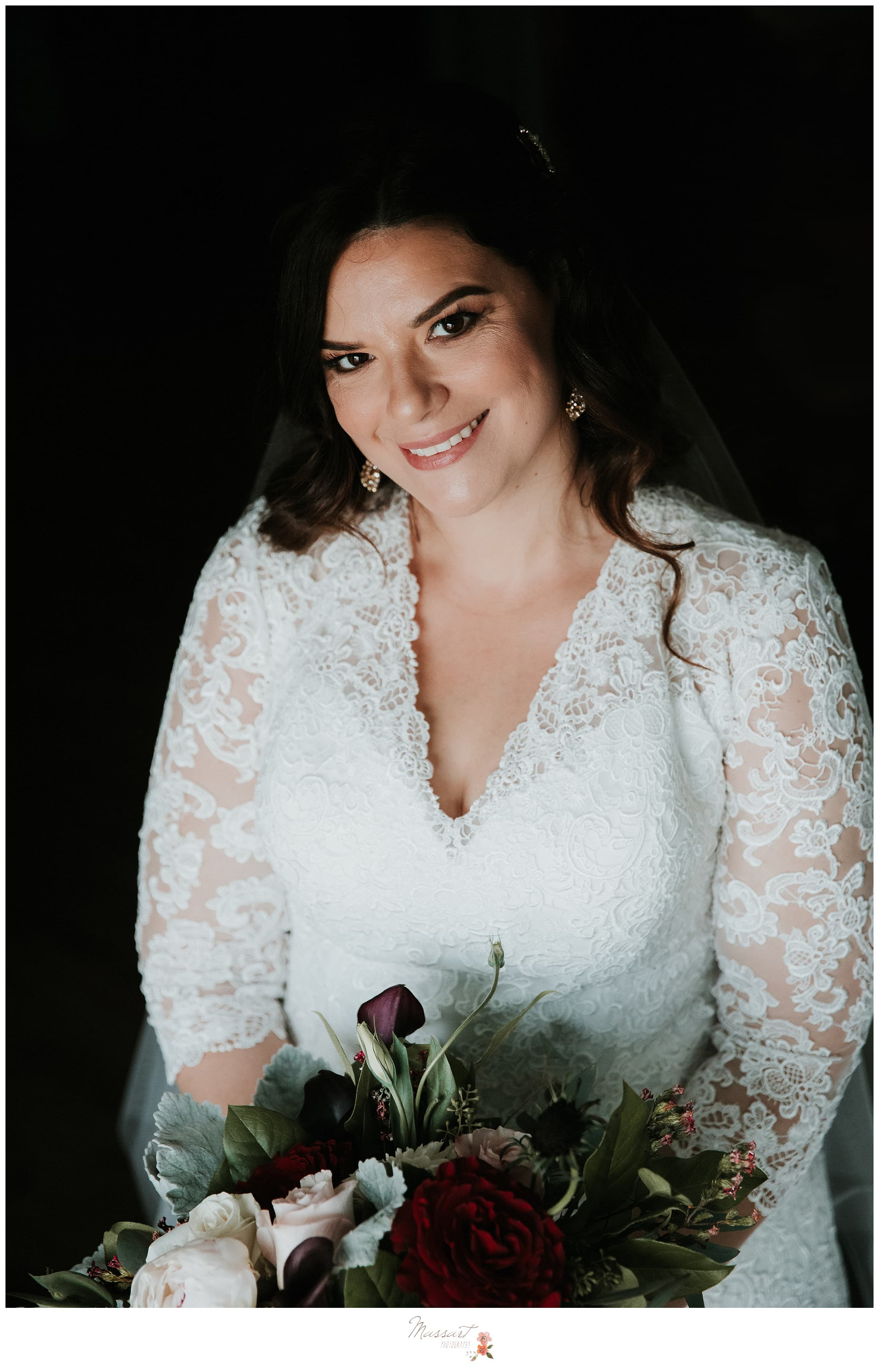 Portrait of the bride at the atlantic resort hotel in newport, RI by massart photographers