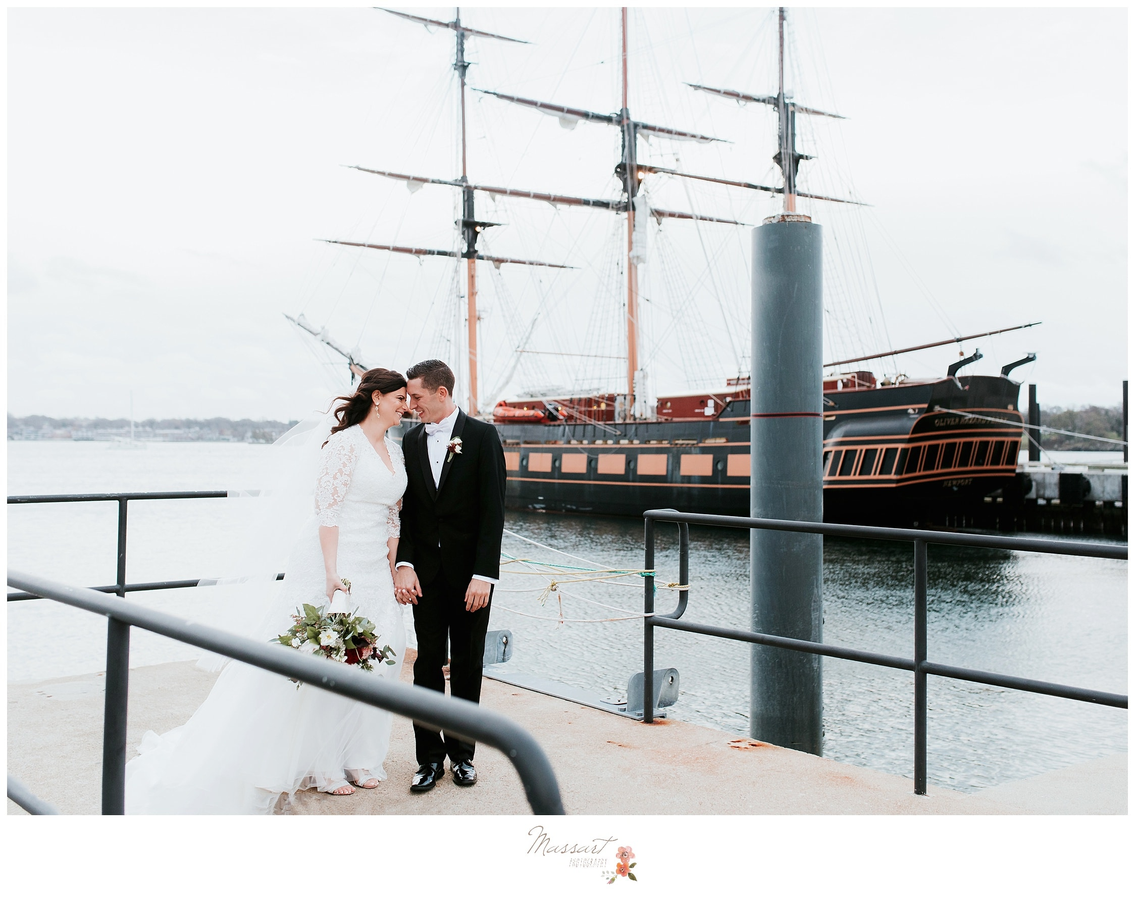 Bride and groom pose in front of a tall ship at Fort Adams Newport, captured by massart photography of RI