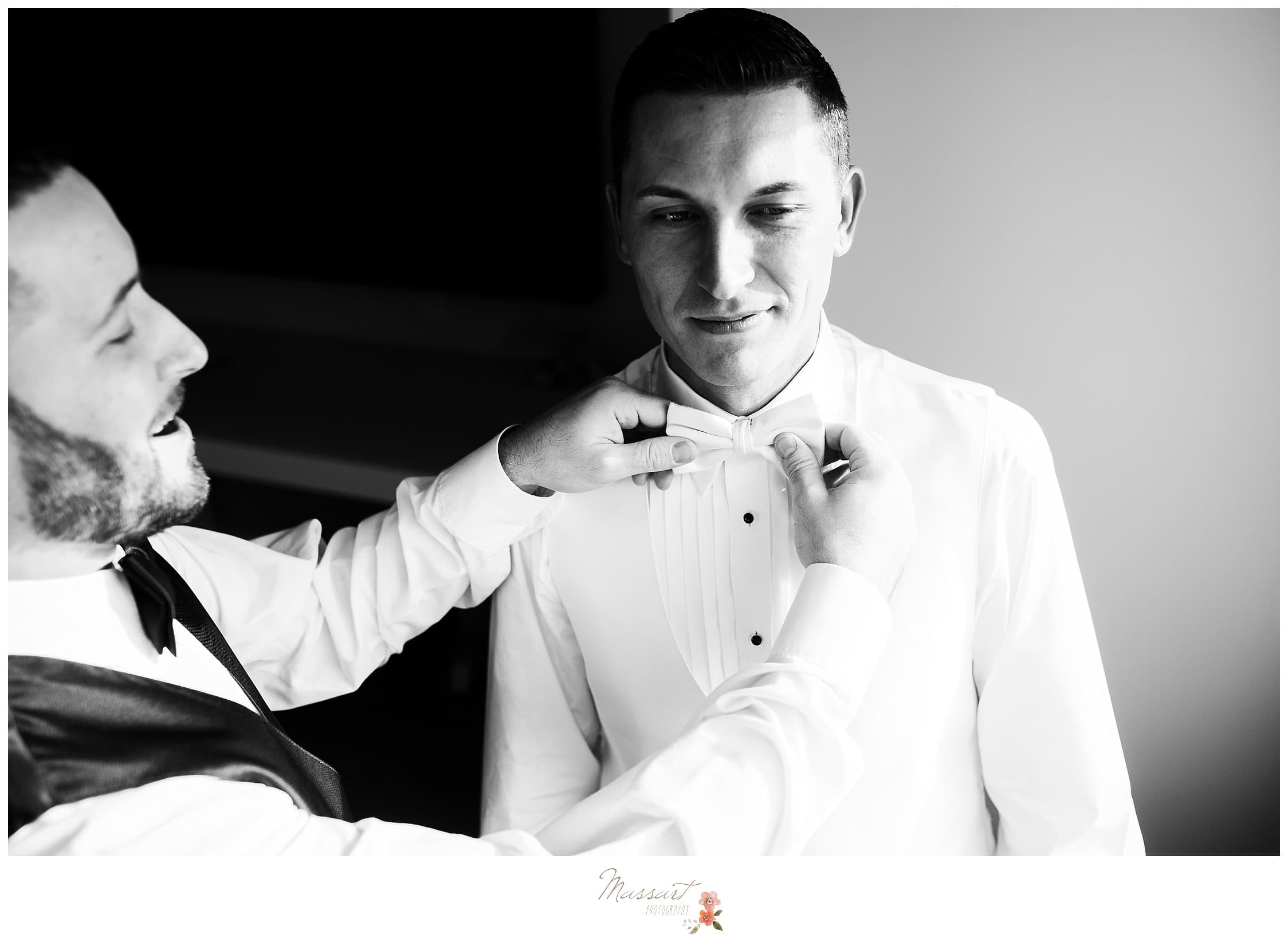 Groom gets ready with best man at the atlantic resort in Rhode Island