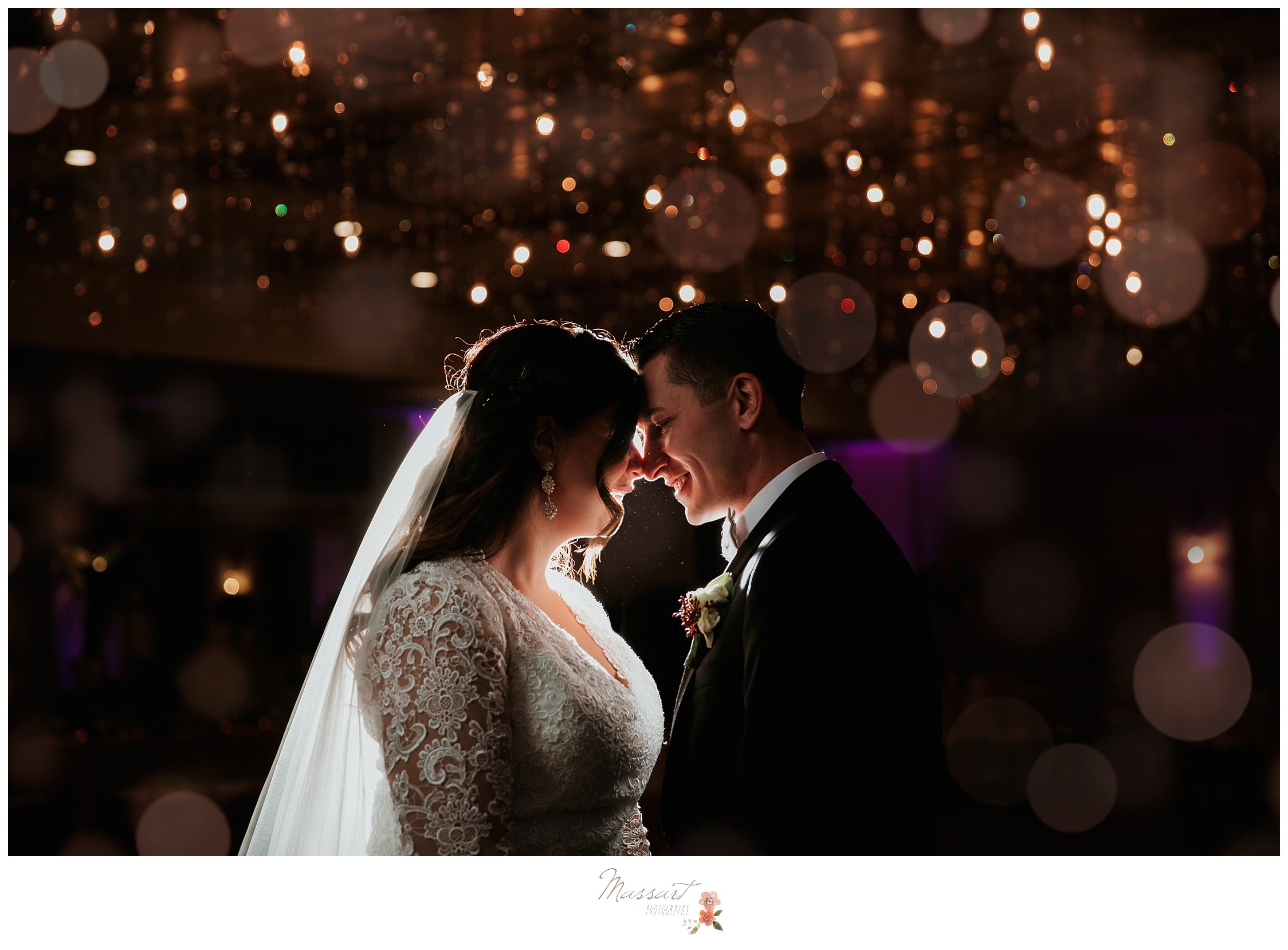 A dramatic wedding photo of the bride and groom under the twinkle stars at the atlantic resort ballroom in newport rhode island
