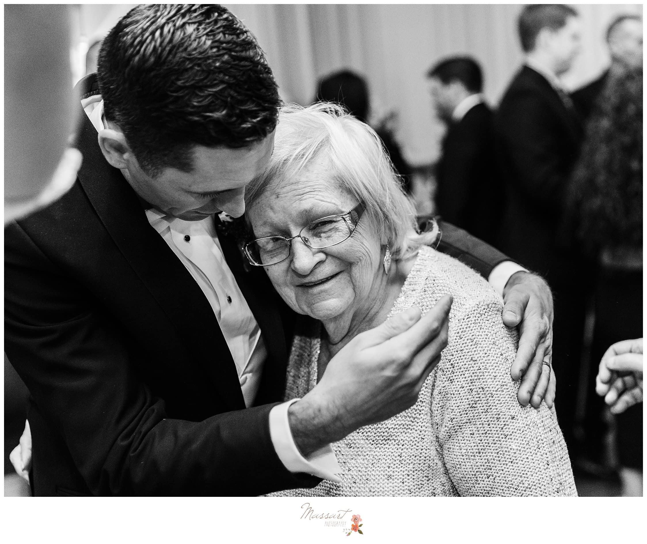 Groom and grandmother shared a touching moment and are captured by photographers of massart photography in rhode island