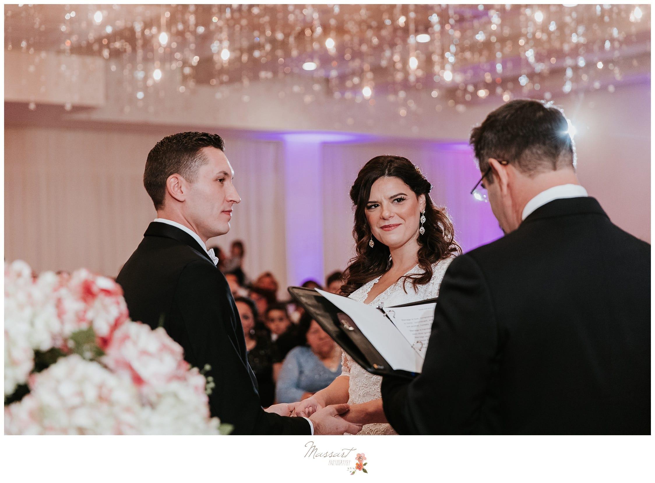 Massart photographers from warwick, RI photograph a wedding ceremony in the ballroom at the atlantic resort in newport