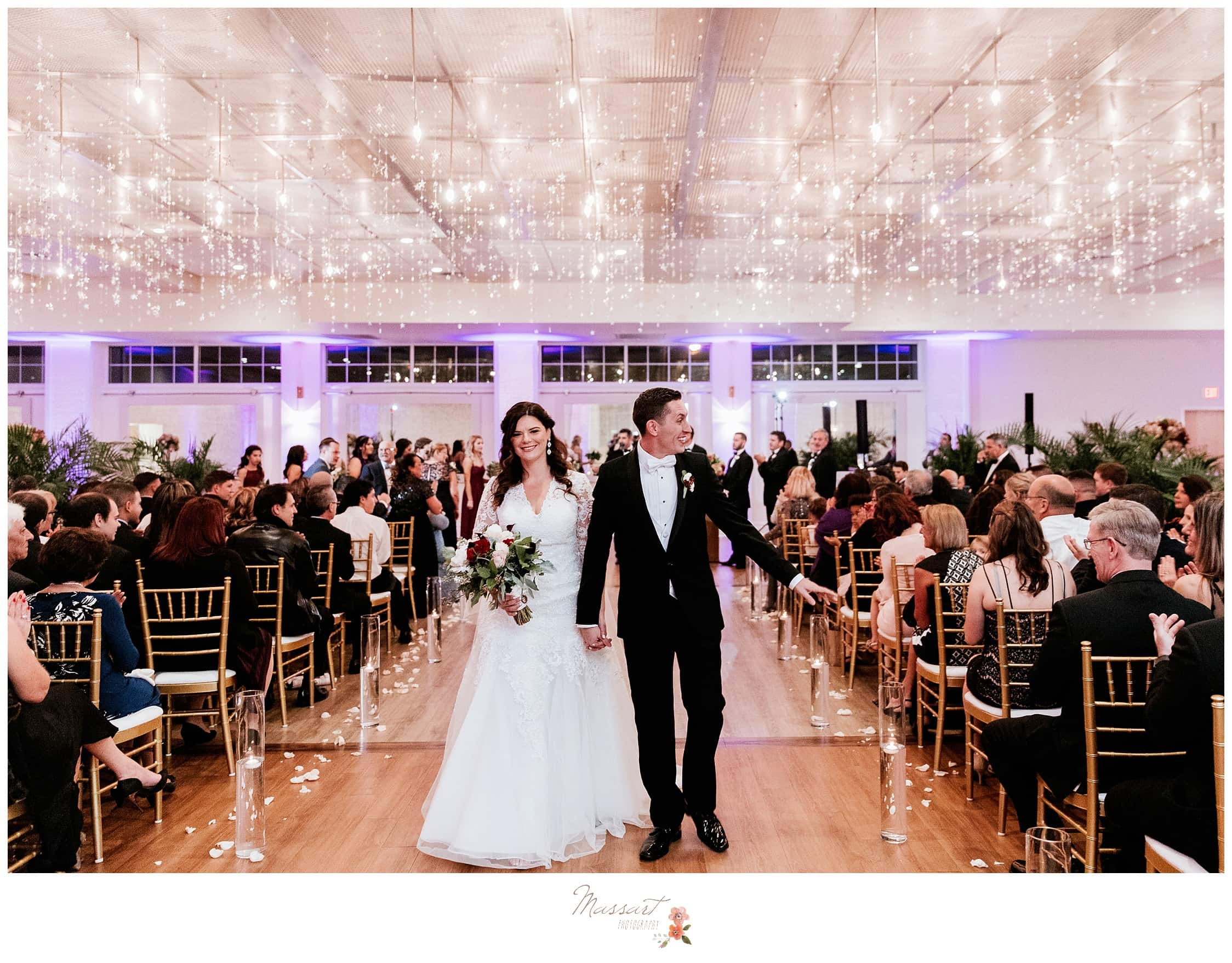 Couple exits after wedding ceremony at the atlantic resort in RI and is captured by massart photographers