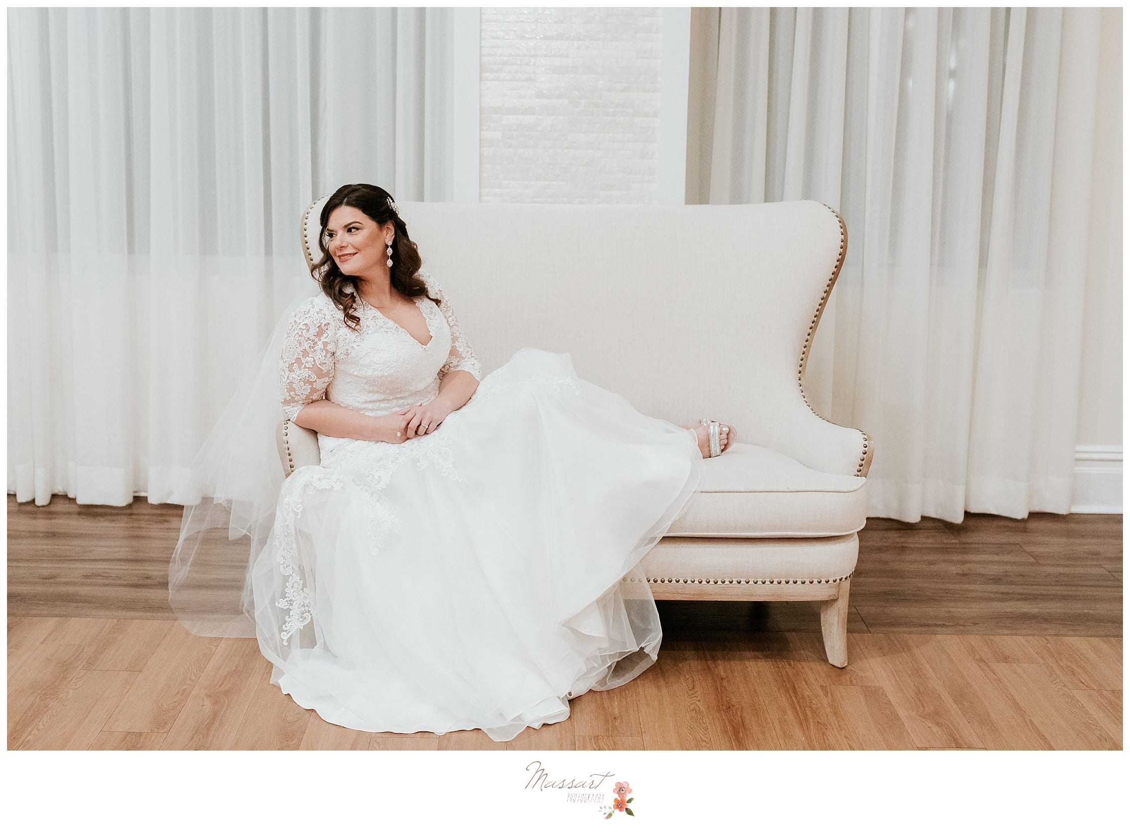 The bride poses for a portrait before the wedding ceremony begins at the atlantic resort in newport, rhode island