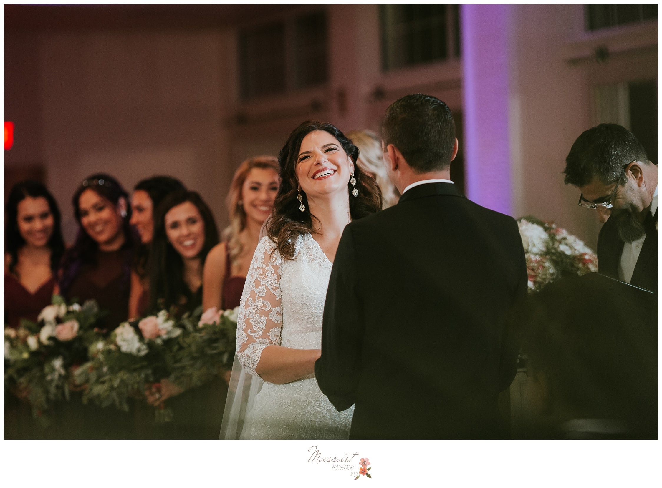 A wedding ceremony in the ballroom of the atlantic resort photographed by massart photographers of warwick RI