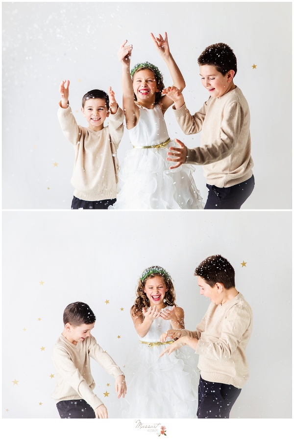 Family holiday portrait session having fun with fake snow photographed by Massart Photography rhode Island