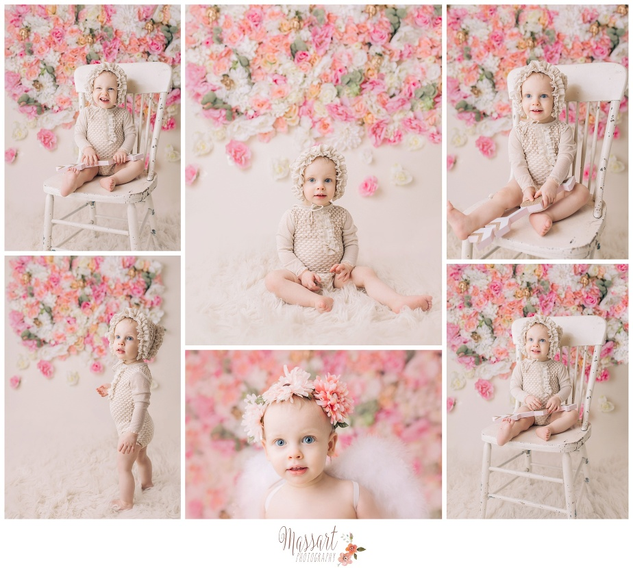 Baby photo with a floral backdrop flower wall by Massart Photographers in their warwick, Rhode Island photography studio. Also servicing CT and MA