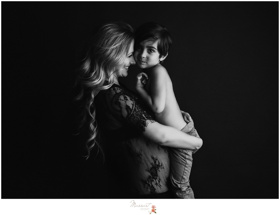 Black and white portrait of mother and son at maternity session by Massart Photography photographers in RI, CT and MA
