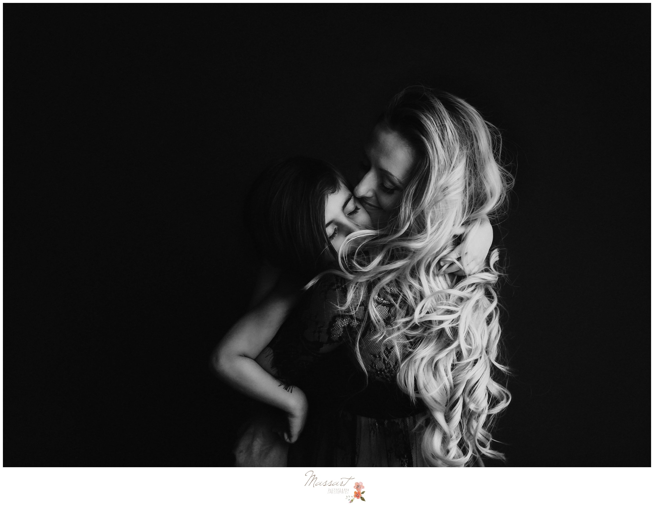 Classic and timeless image of mother and son during maternity session by Massart Photography