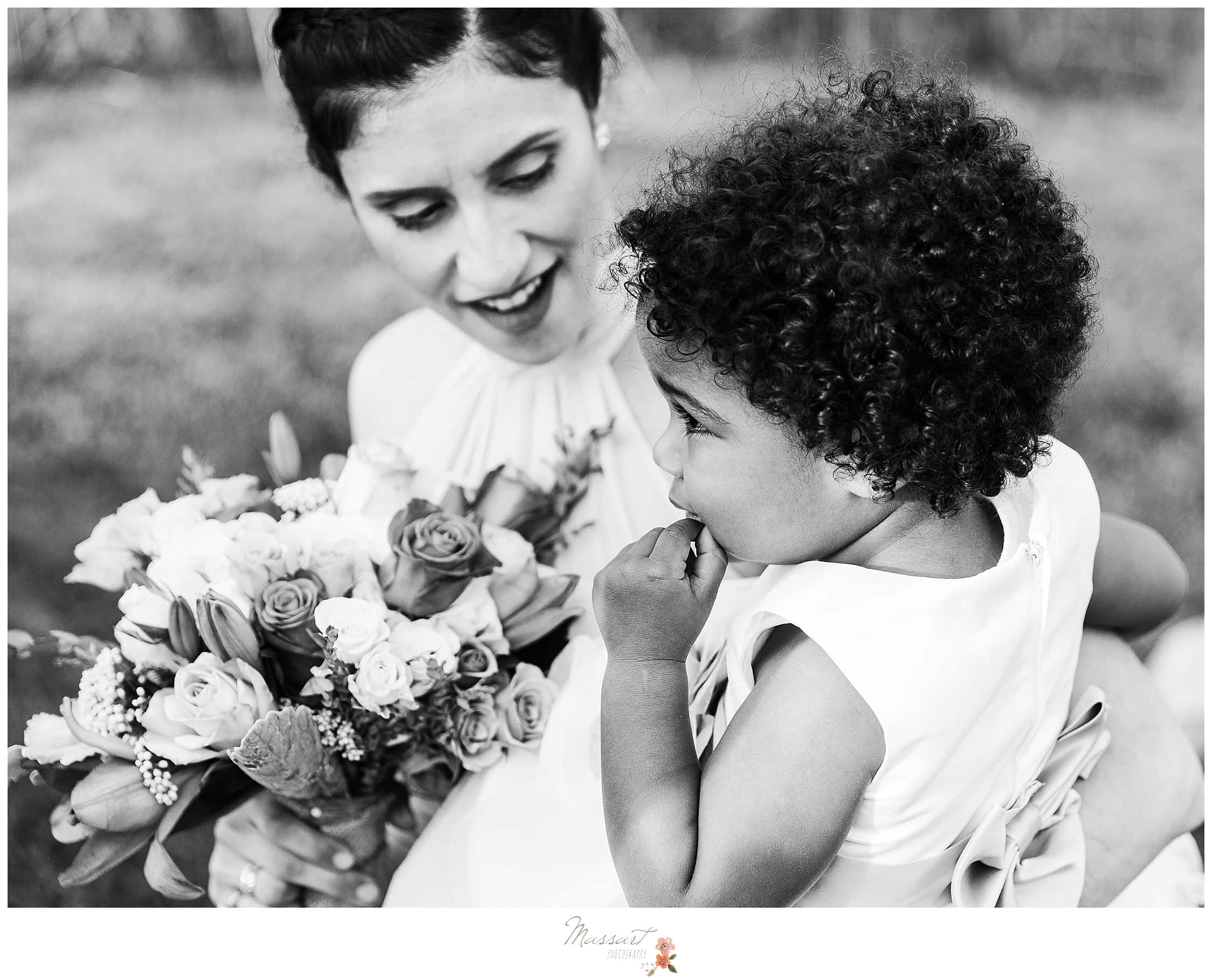 Bride with flower girl waiting for wedding photographed by RI wedding photographers Massart Photography.