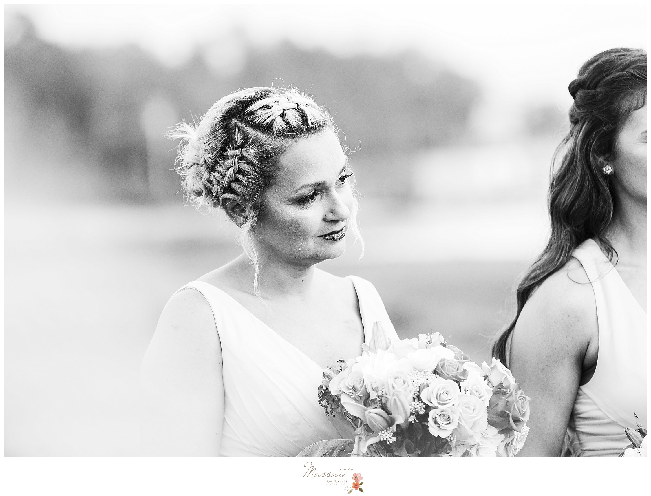 Bridesmaid gets emotional during wedding ceremony at Harbor Lights in RI photographed by MA, CT and RI wedding photographers Massart Photography.